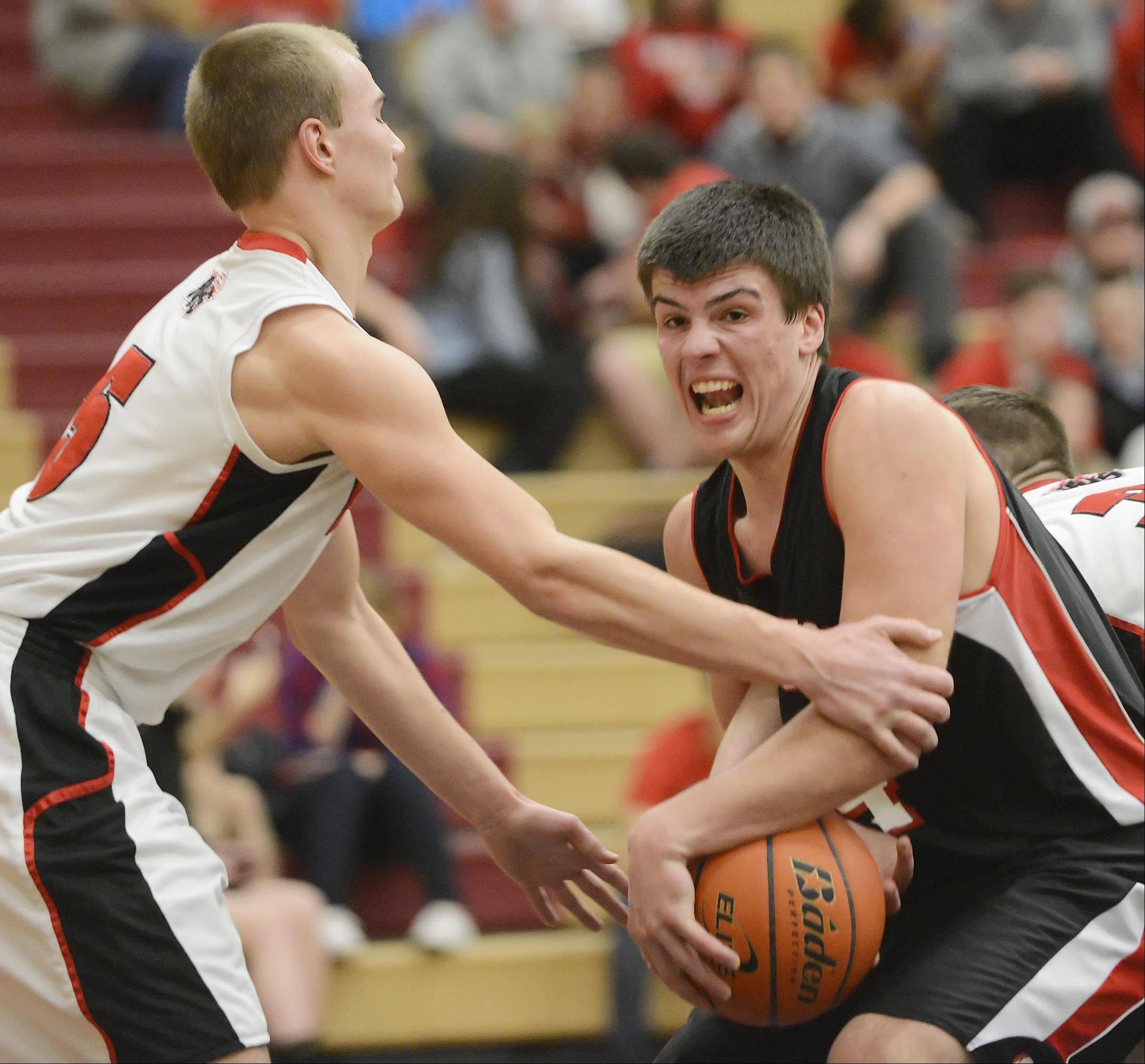 Barrington's Zach Bart is fouled by Huntley's Blake Jacobs.