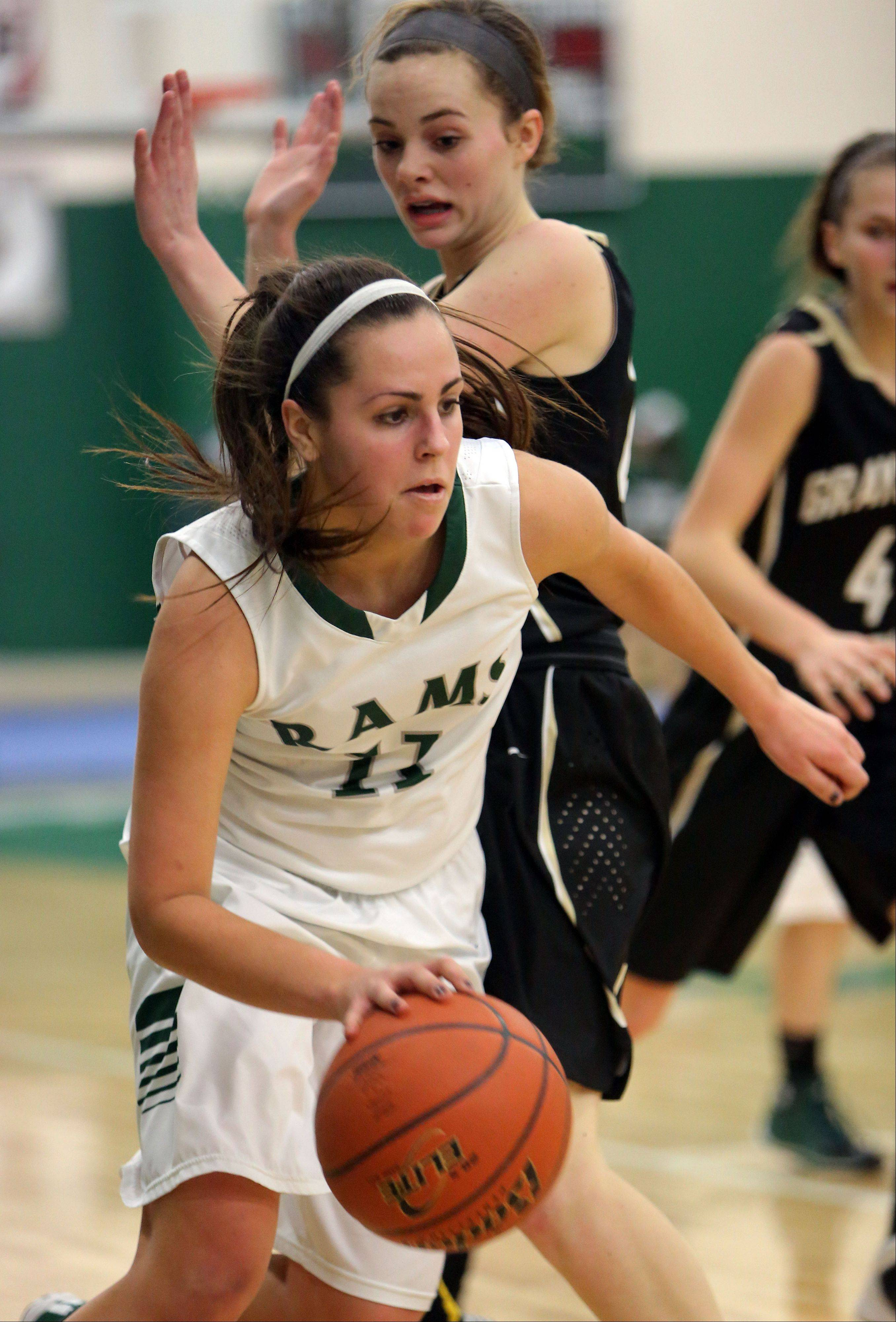 Grayslake Central's Carson Sparkman, left, drives past Grayslake North's Sidney Lovitsch Wednesday night at Grayslake Central.