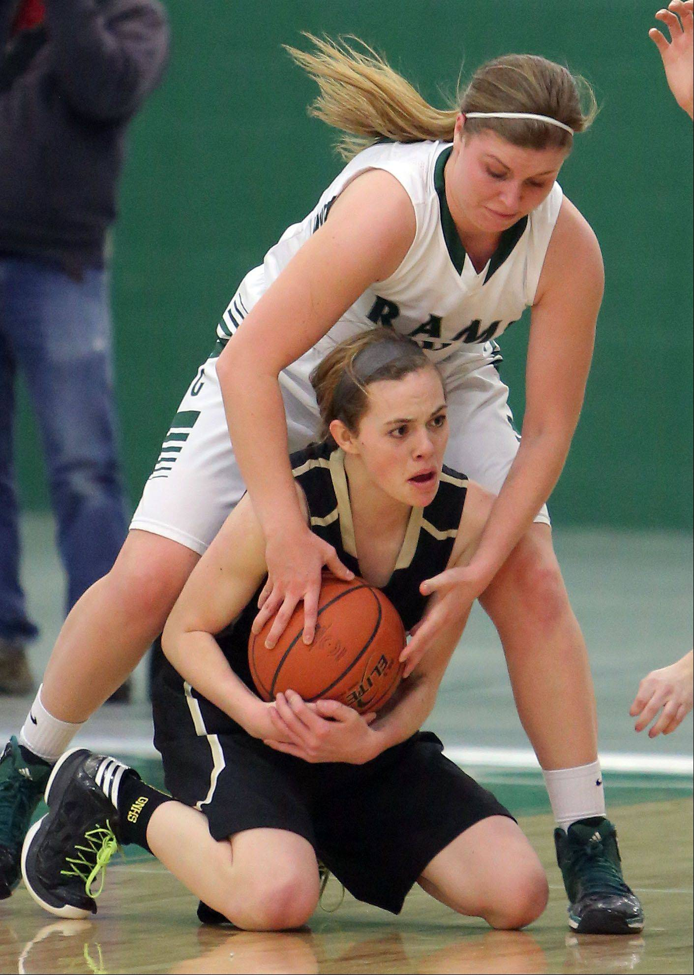 Grayslake North's Sidney Lovitsch, bottom, tries to control a loose ball as Grayslake Central's Maddy Miller defends Wednesday night at Grayslake Central.