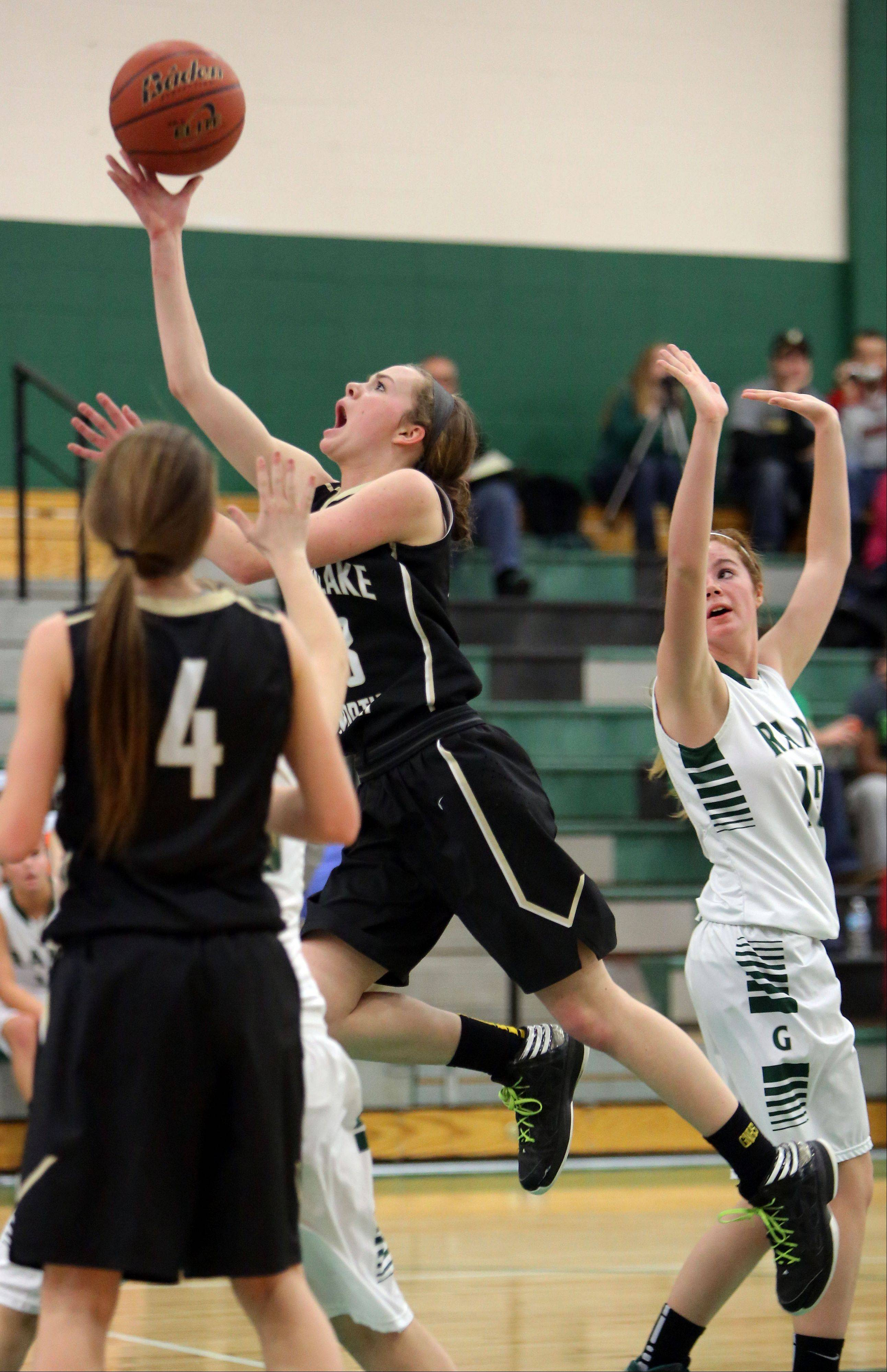 Grayslake North's Sidney Lovitsch, left, drives past Graylake Central's Lauren Spalding on Wednesday at Grayslake Central.