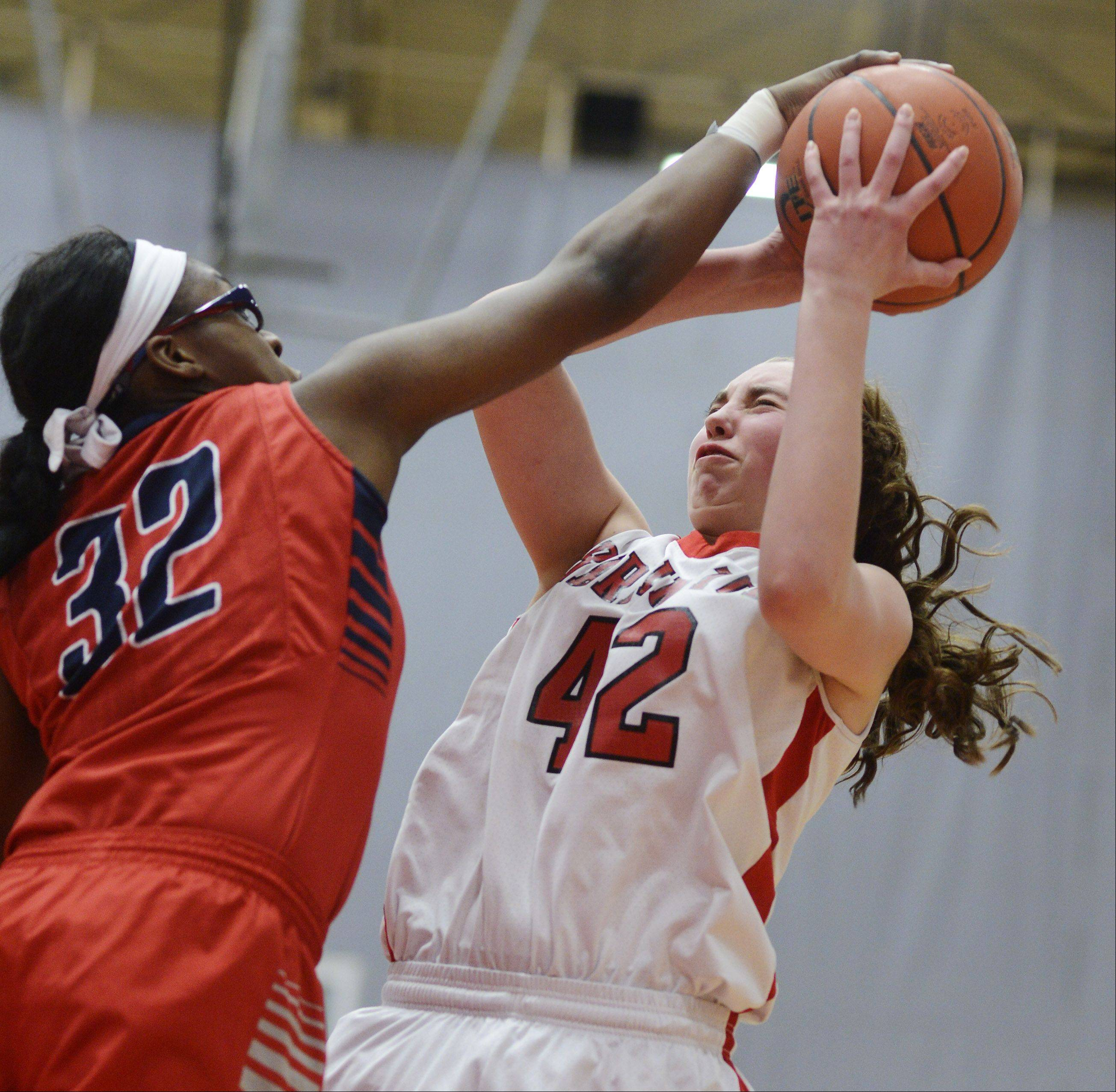 South Elgin's Bridgette Williams, left, blocks a shot by Barrington's Megan Talbot during Wednesday's game at Barrington.