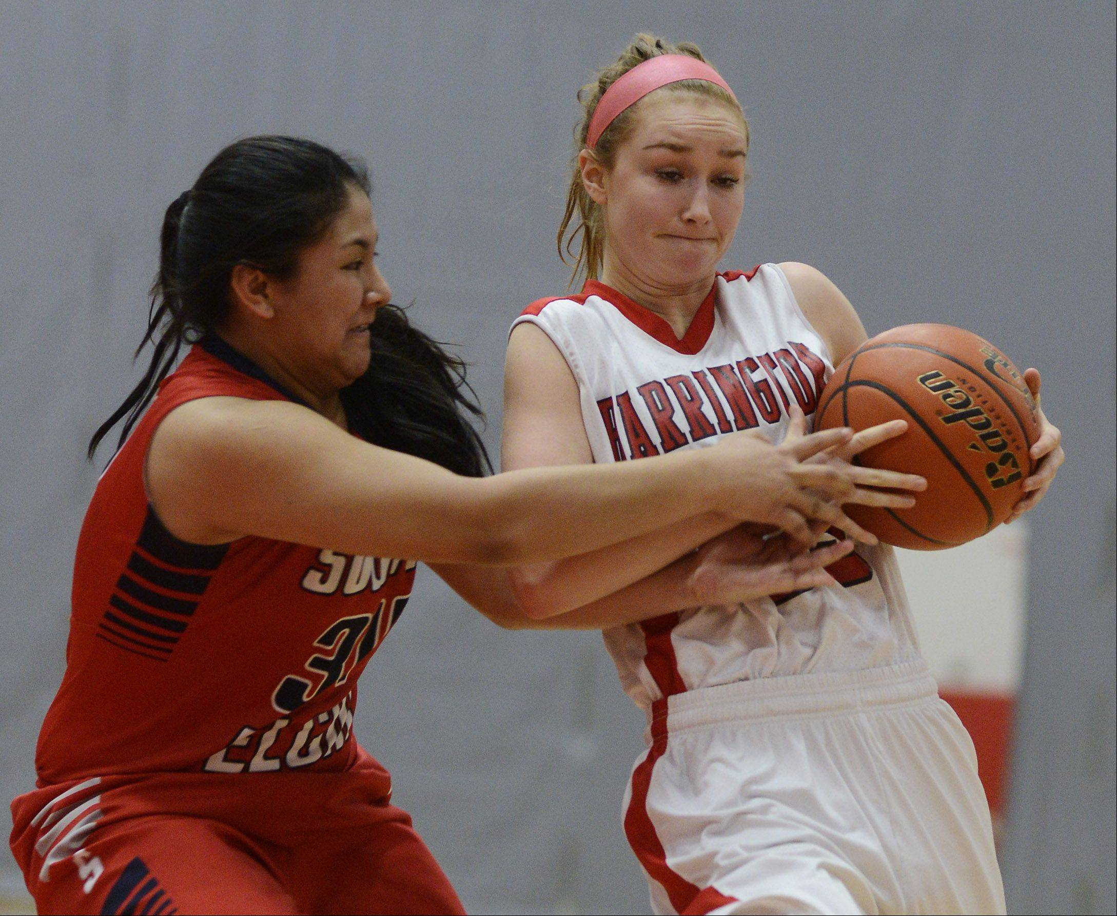 South Elgin's Nadia Yang, left, tries to steal the ball from Barrington's Brooke Gunderson.