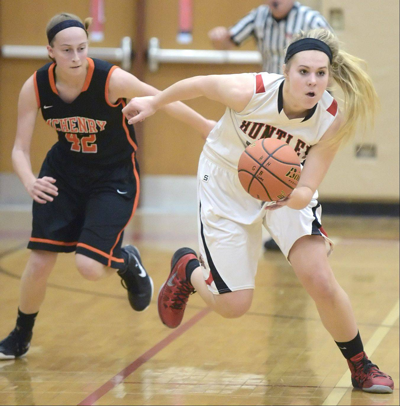 Huntley's Ali Andrews grabs a loose ball as she is trailed by McHenry's Katlyn Sena in the second quarter.
