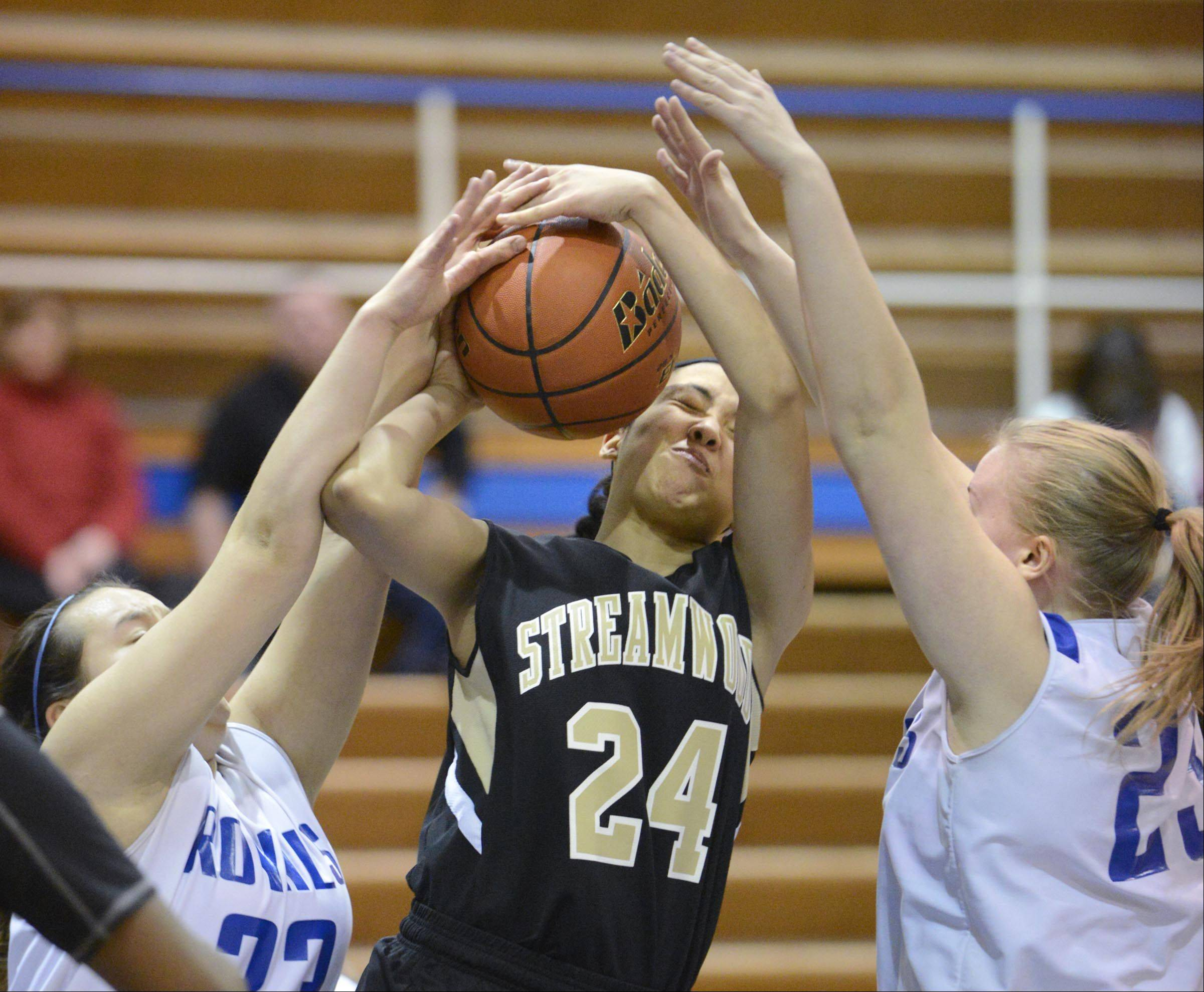 Streamwood's Kiana Jeremiah is blocked by Larkin's Rachel Martinez and Haley Casebeer, right, Thursday in Elgin.