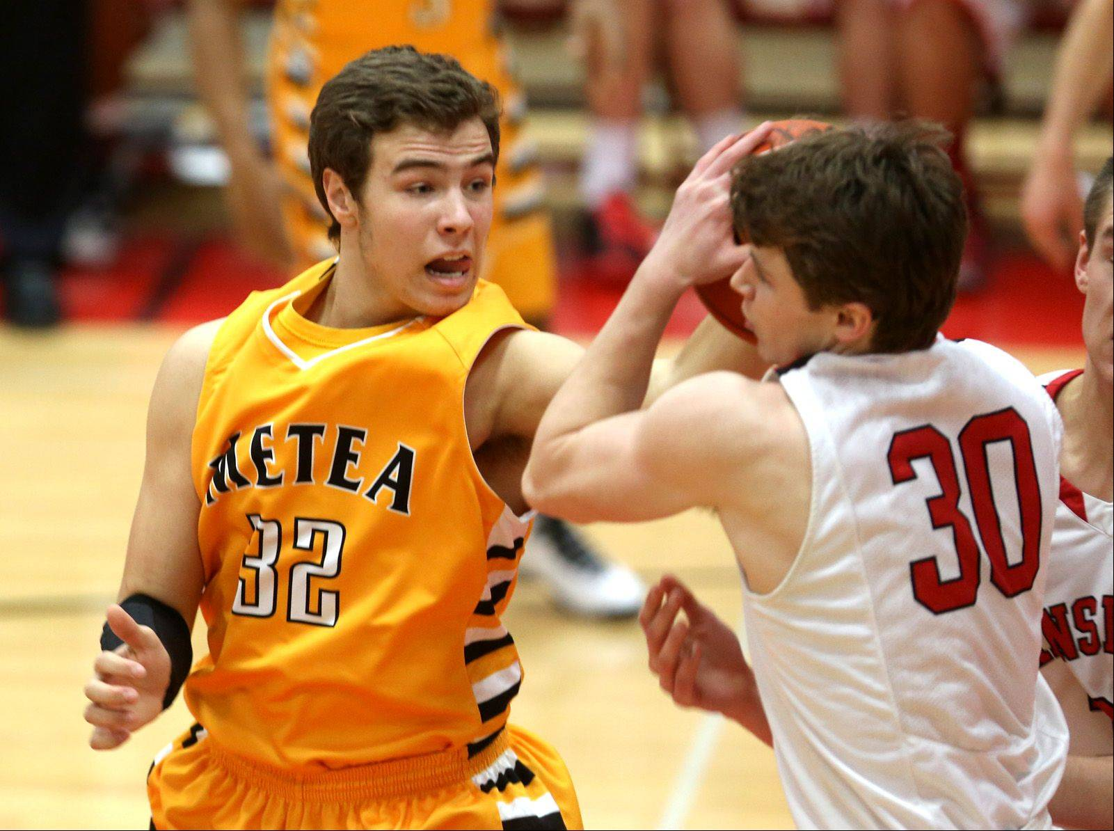 Metea Valley's Mark Konkle (32), defends Hinsdale Central's Chase Hamilton (30), right, during a 56-40 loss to the Red Devils in Hinsdale, Friday.
