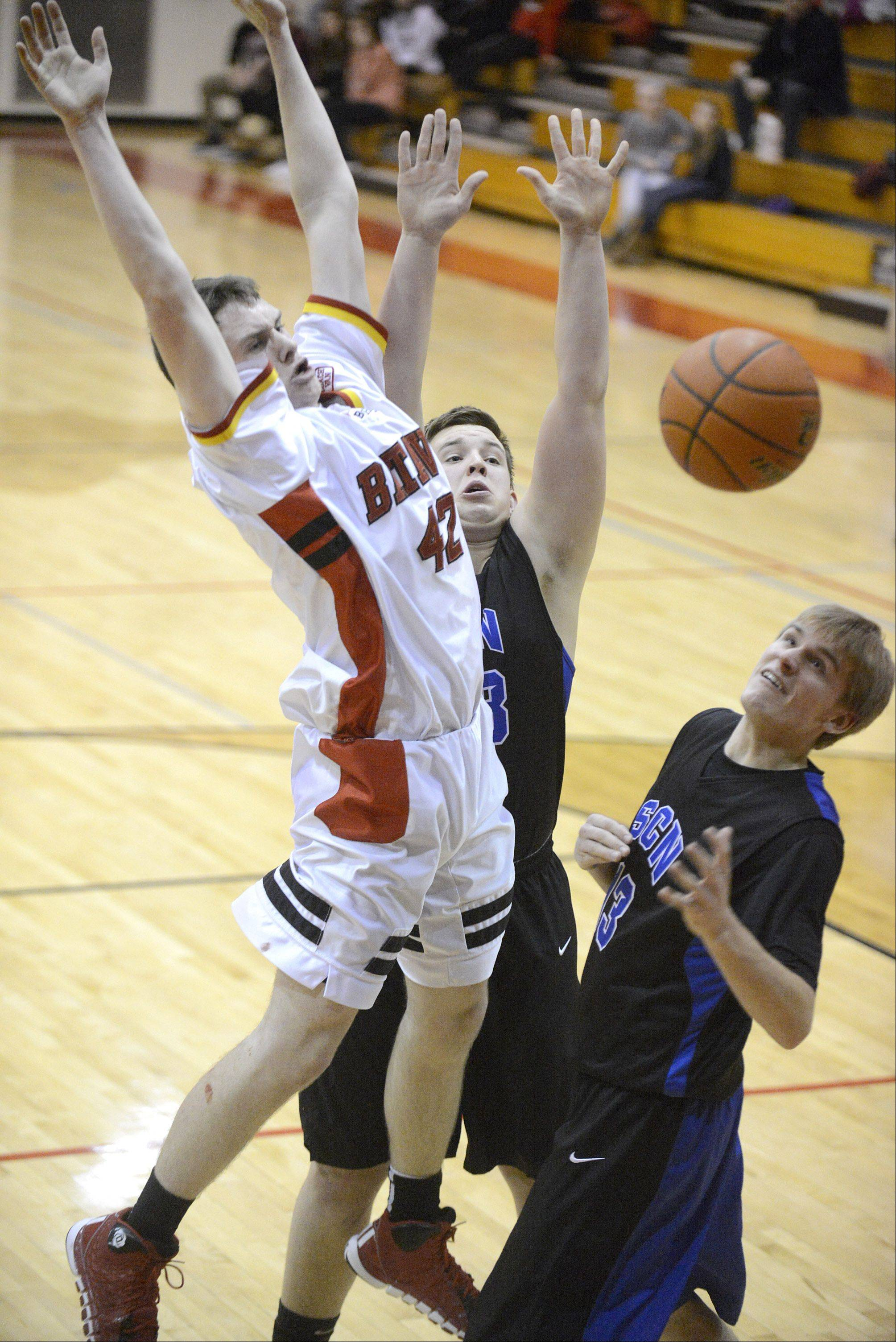 Batavia's Ryan Olson goes up for the hoop near St. Charles North's Camden Cotter (center) and David Pozna (right) in the third quarter on Friday.