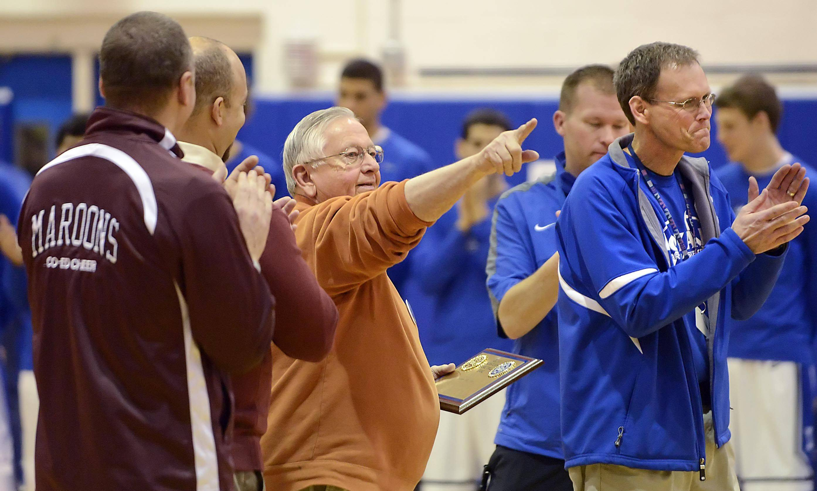 Elgin Superfan Dave St. John points to the crowd after receiving a plaque for his decades of support for Elgin teams Friday at Larkin High School in Elgin.