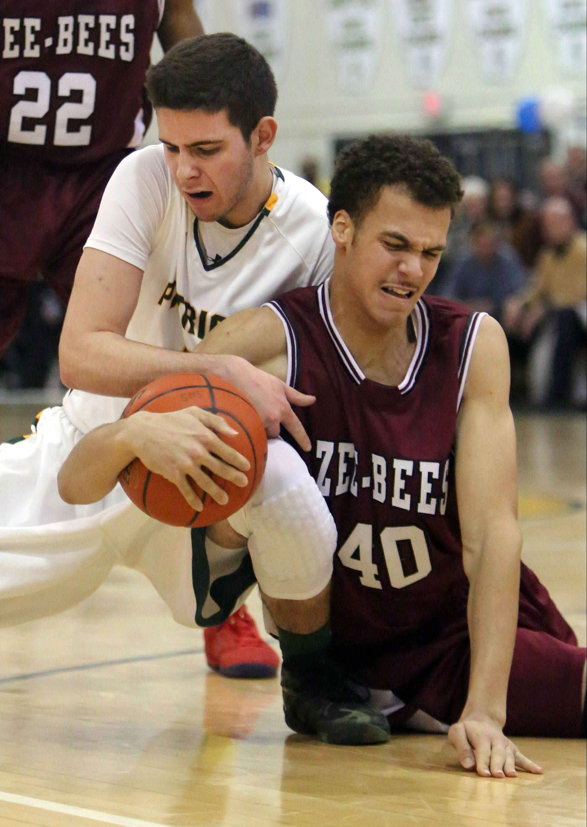 Stevenson's Sam Panitch, left, and Zion Benton's Chris Moragne fight for a loose ball during NSC Lake play Friday night at Stevenson.
