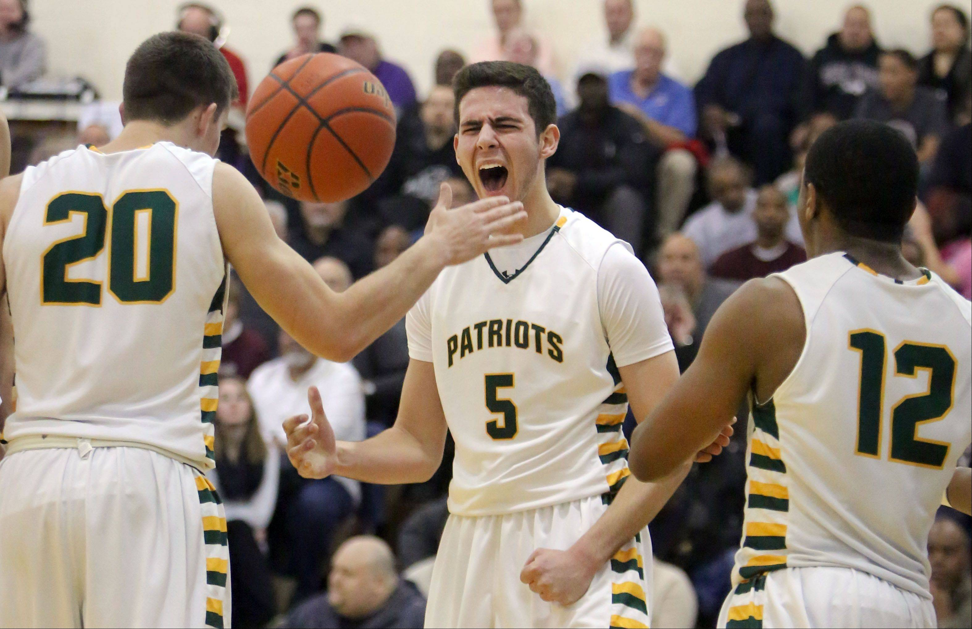 Stevenson's Sam Panitch (5) celebrates with Matt Morrissey, left, and Matt Johnson during NSC Lake play Friday night at Stevenson.