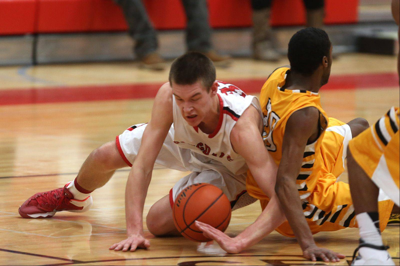 Hinsdale Central's Matt Rafferty, left battles Metea Valley's Marquell Oliver, right.