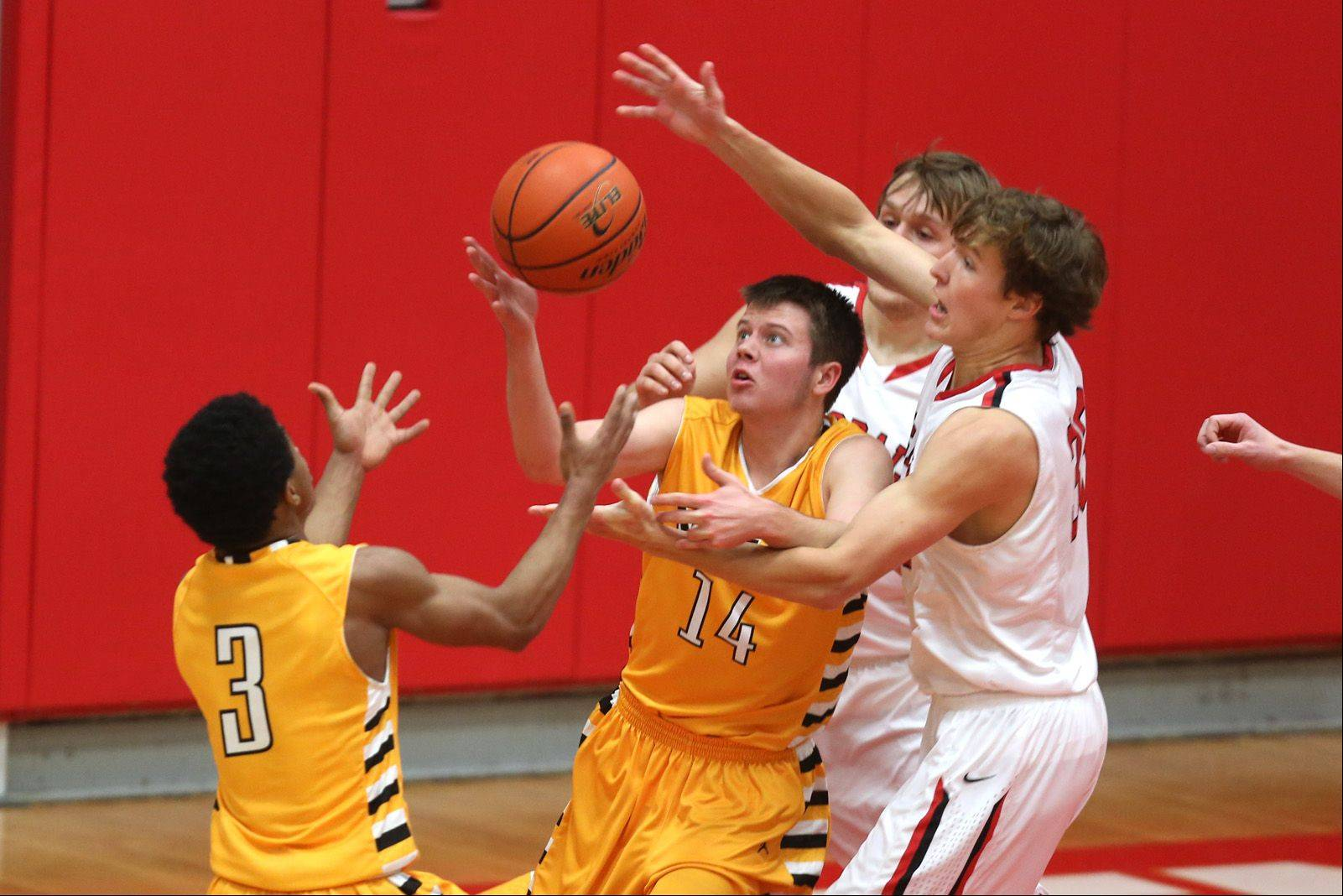 Metea Valley's Bryson Oliver and Nick Klepper move into Hinsdale Central's Grant Lillard, right.