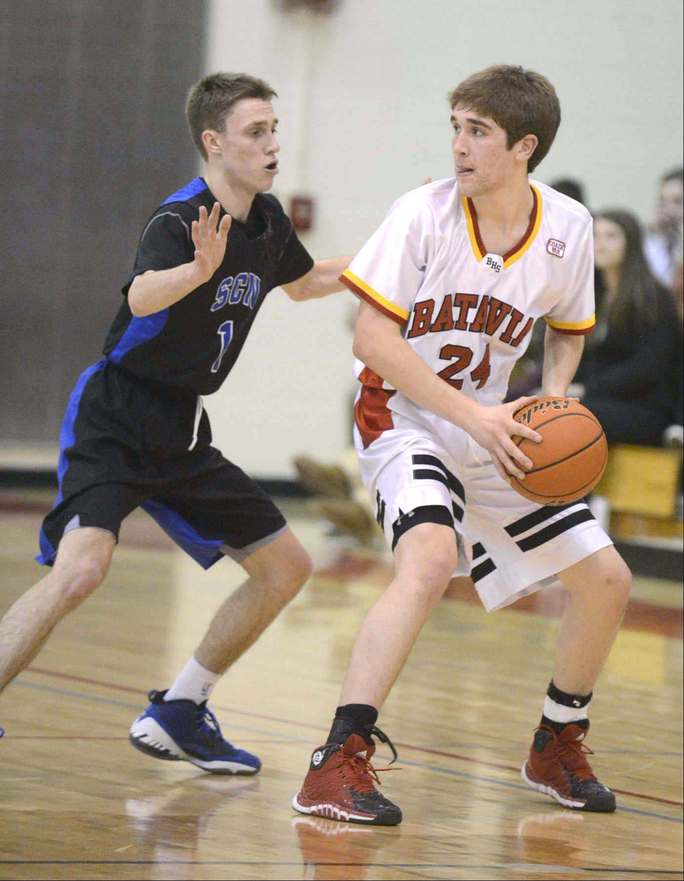 Images from the St. Charles North at Batavia boys basketball game Friday, February 7, 2014 in Batavia.