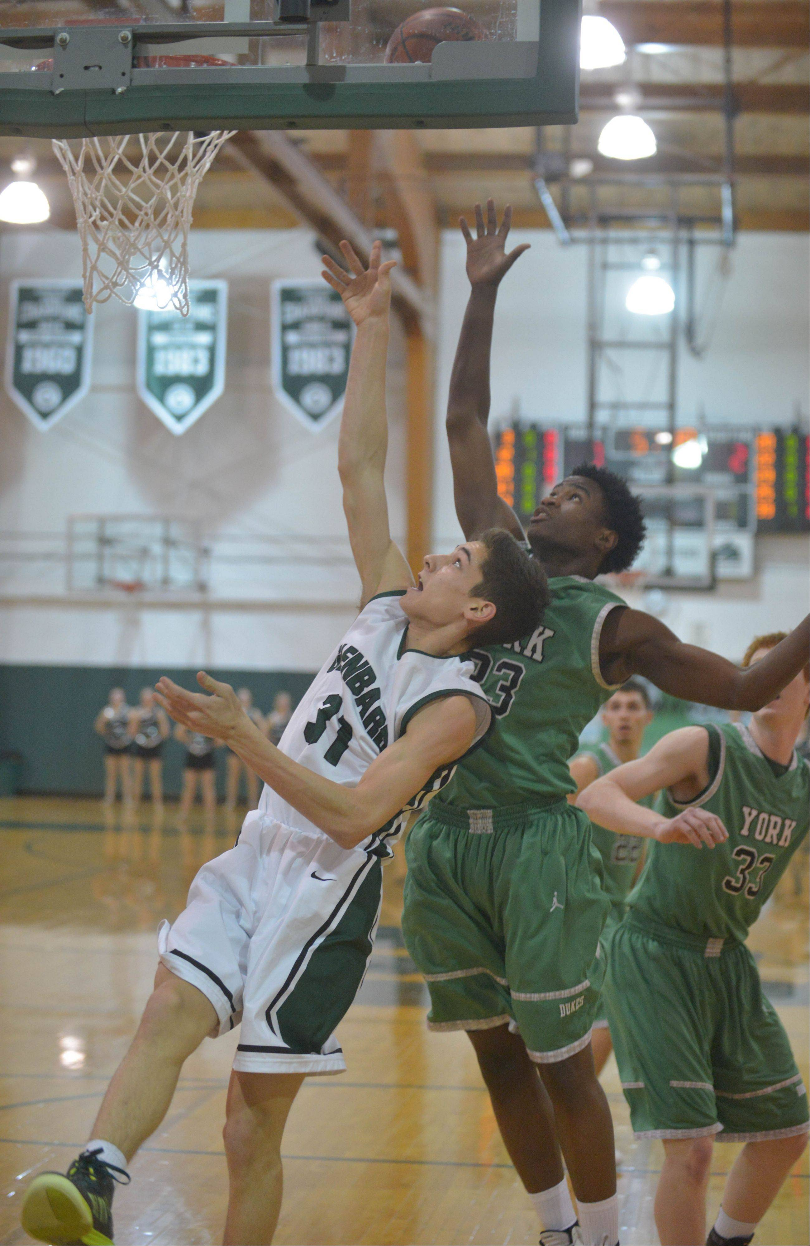Alex Passi of Glenbard West,left, and Jayvon Thomas of York go for a rebound.