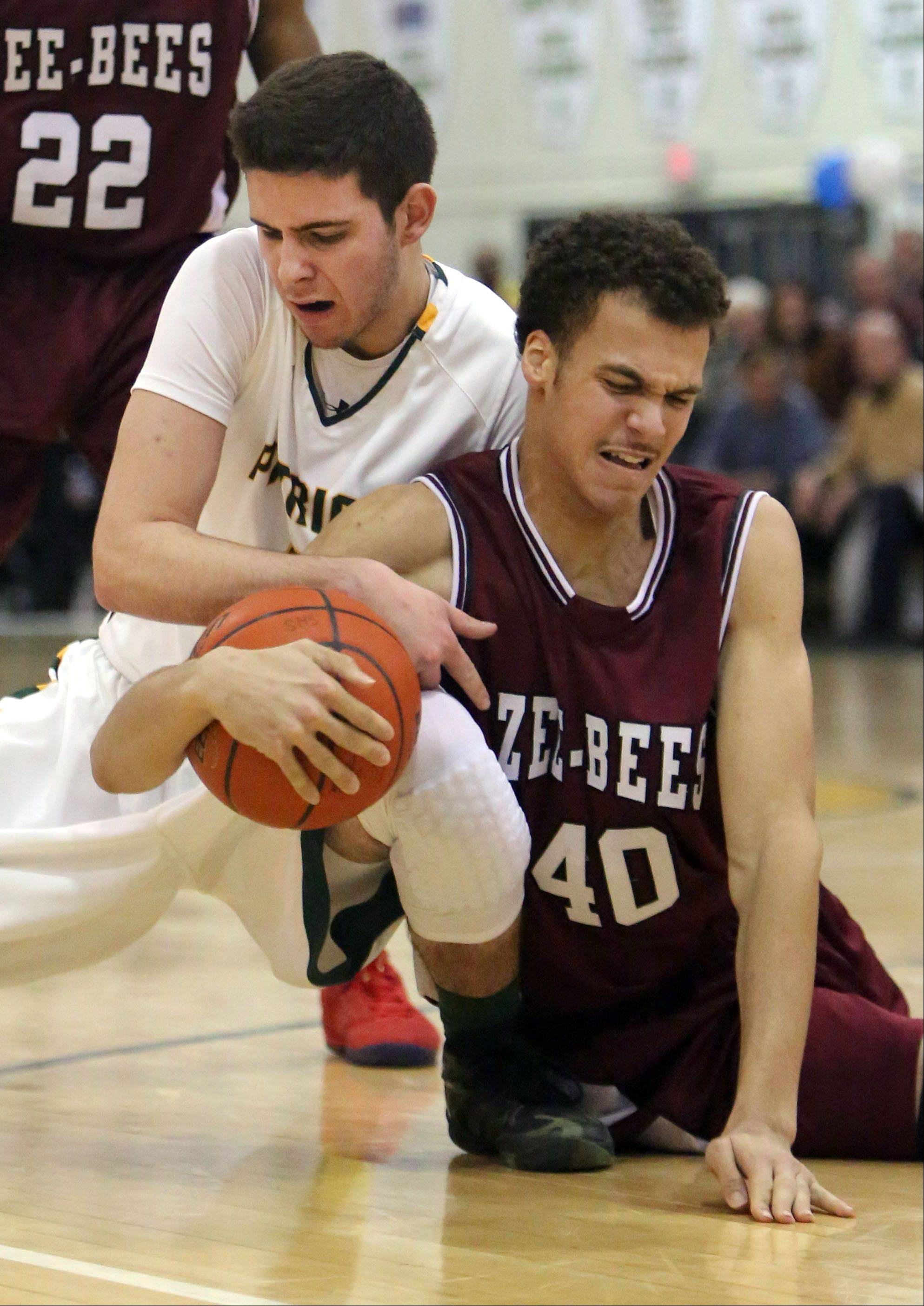Stevenson's Sam Panitch, left, and Zion Benton's Chris Moragne fight for a loose ball.