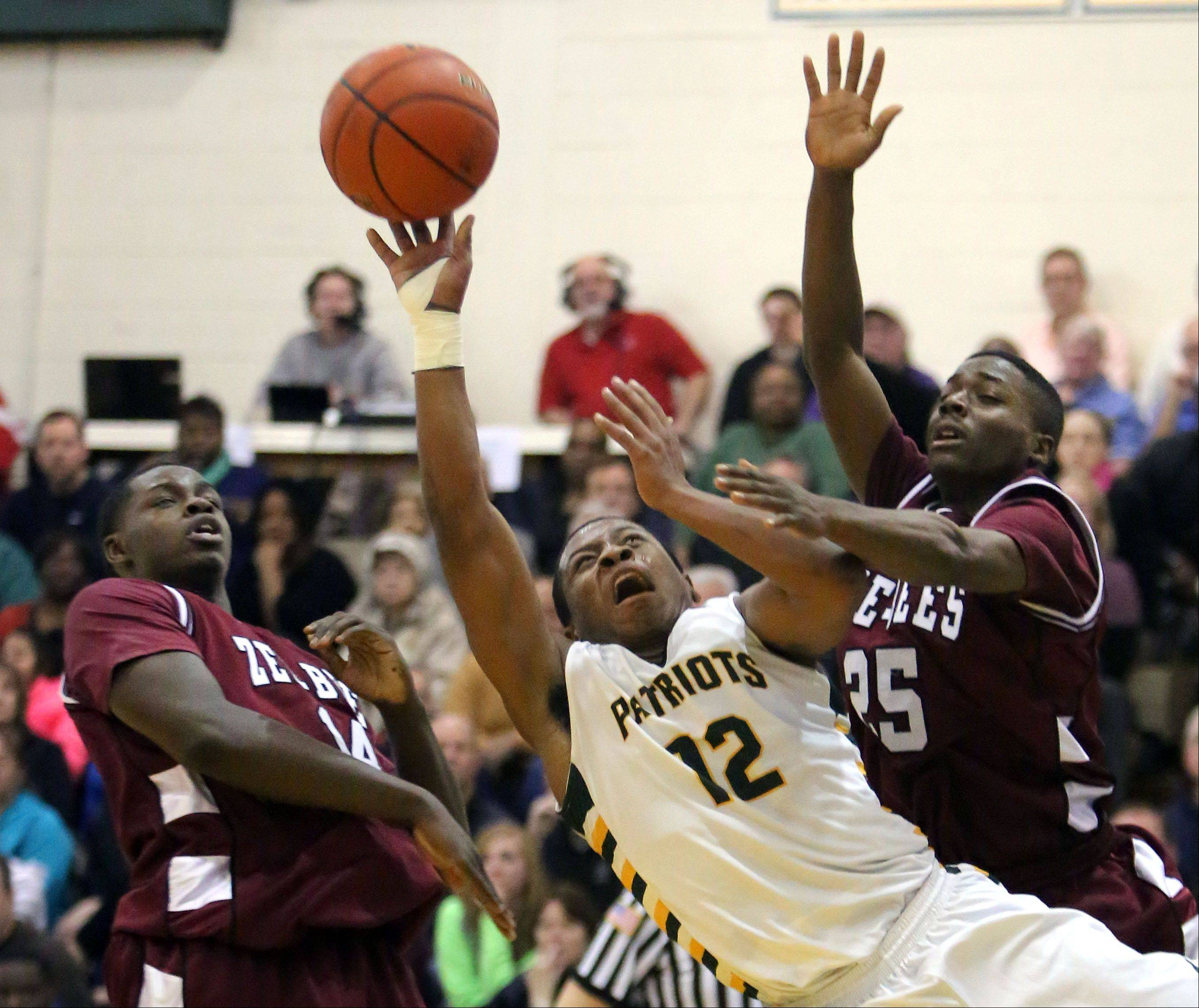 Stevenson's Matt Johnson splits in between Zion-Benton's Milik Yarbrough, left, and Fred Calvert .