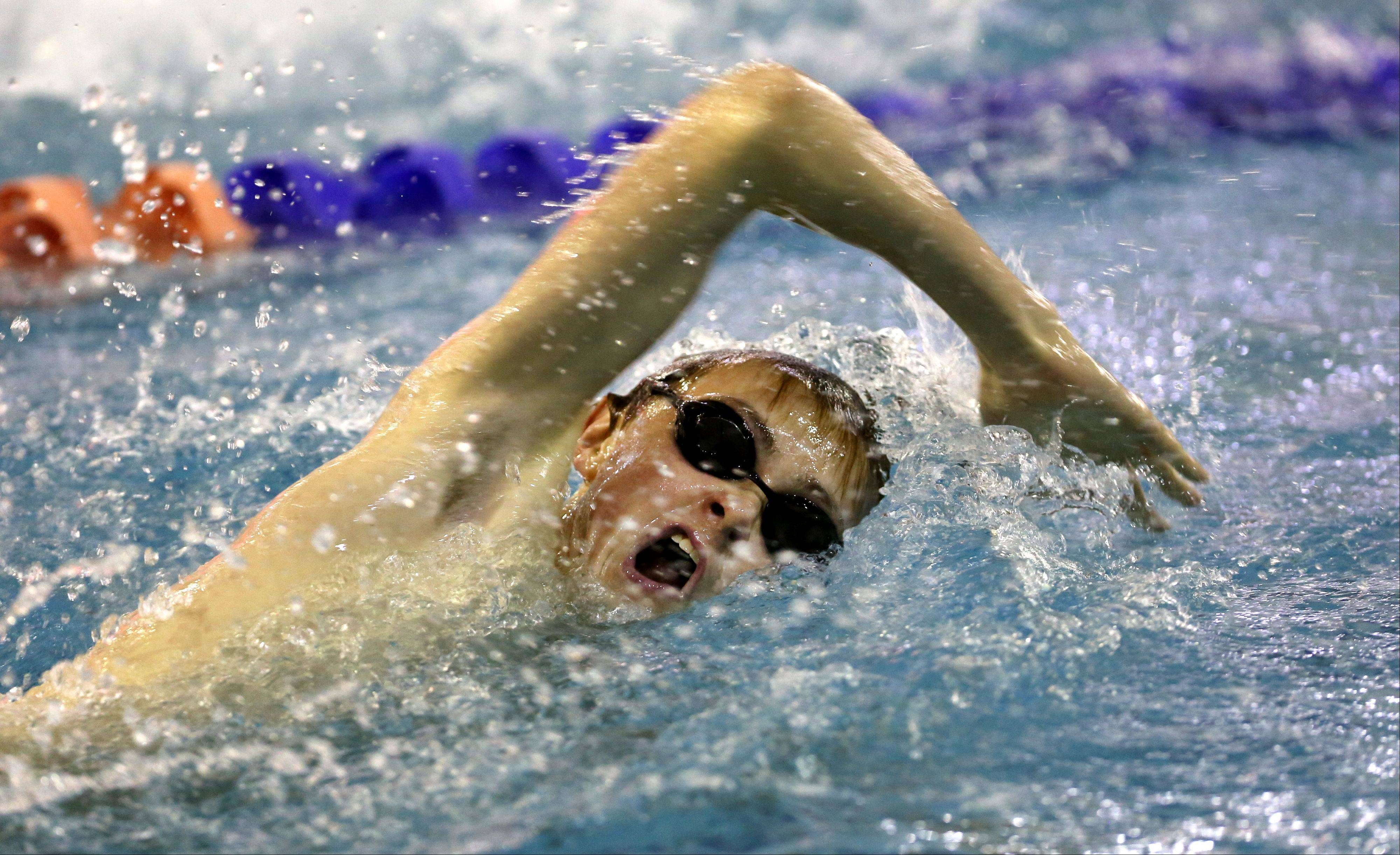 Daniel White/dwhite@dailyherald.comWest Aurora's Martin Ambre swims the first heat of the 100 yard freestyle during the Boys DVC swim meet at Naperville North.