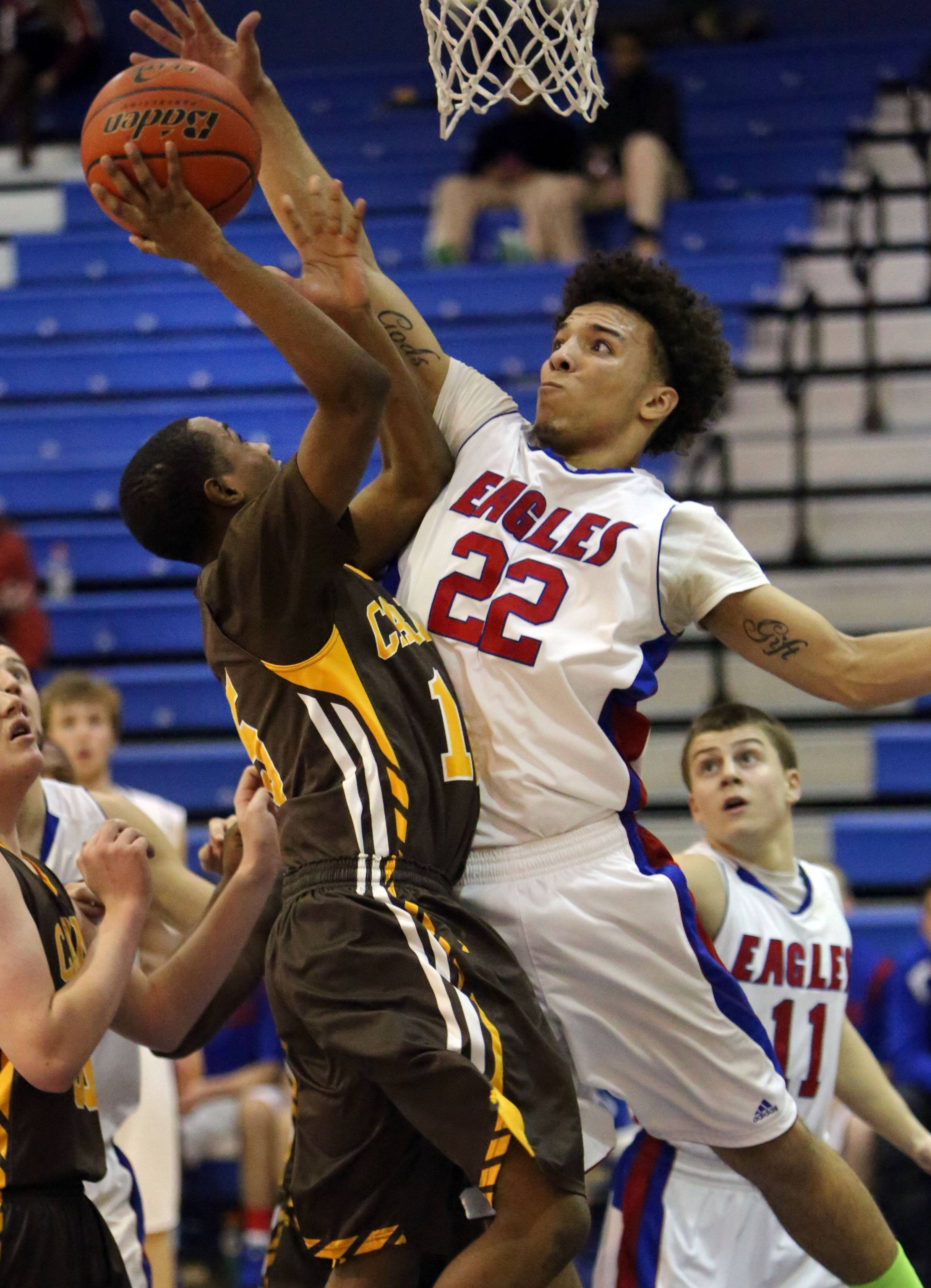Lakes' Tramone Hudson, right blocks the shot of Carmel's Shareif Besler-Bailey on Monday night at Lakes.