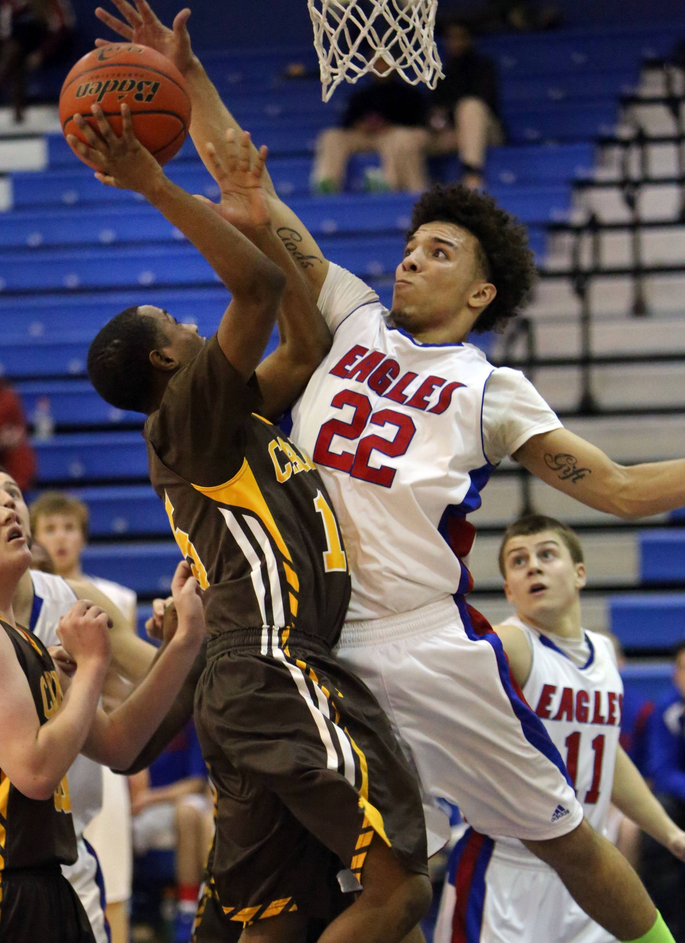 Lakes' Tramone Hudson, right blocks the shot of Carmel's Shareif Besler-Bailey.