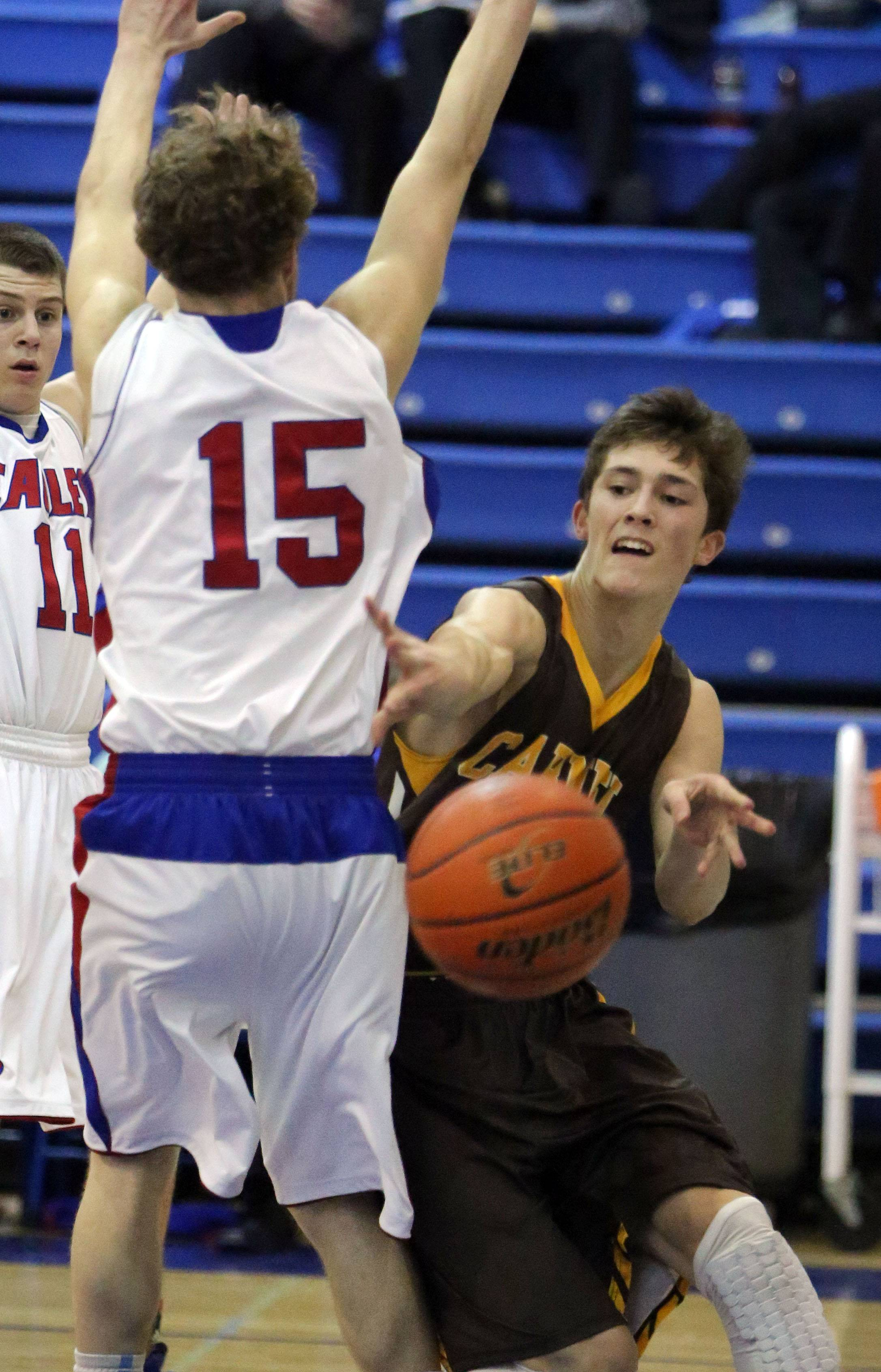 Carmel's Billy Kirby, right, passes around Lakes' Benett Haviland .