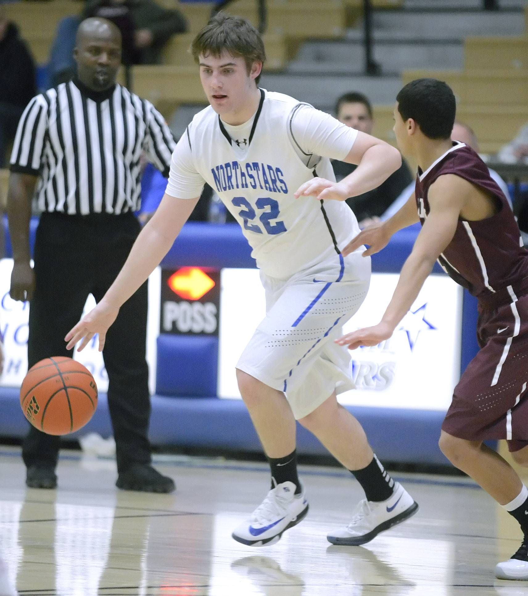 St. Charles North's Jack Callaghan dribbles around Elgin's Desmond Douglas in the fourth quarter of the North Stars' 49-46 win Tuesday in St. Charles.