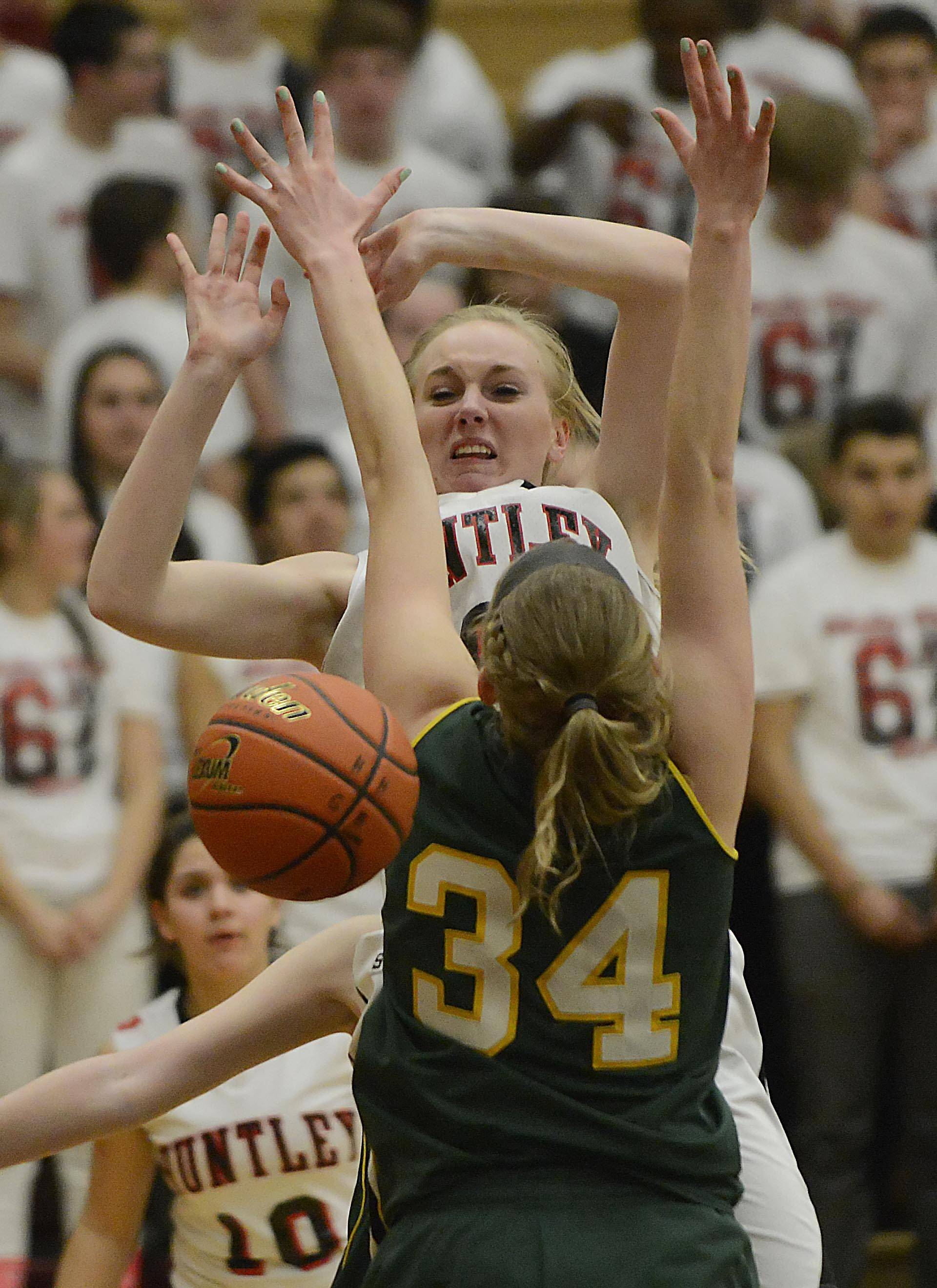 Huntley's Morgan Clausen is stripped of the ball by Crystal Lake South's Chanel Fanter as South's Sara Mickow defends under the basket.