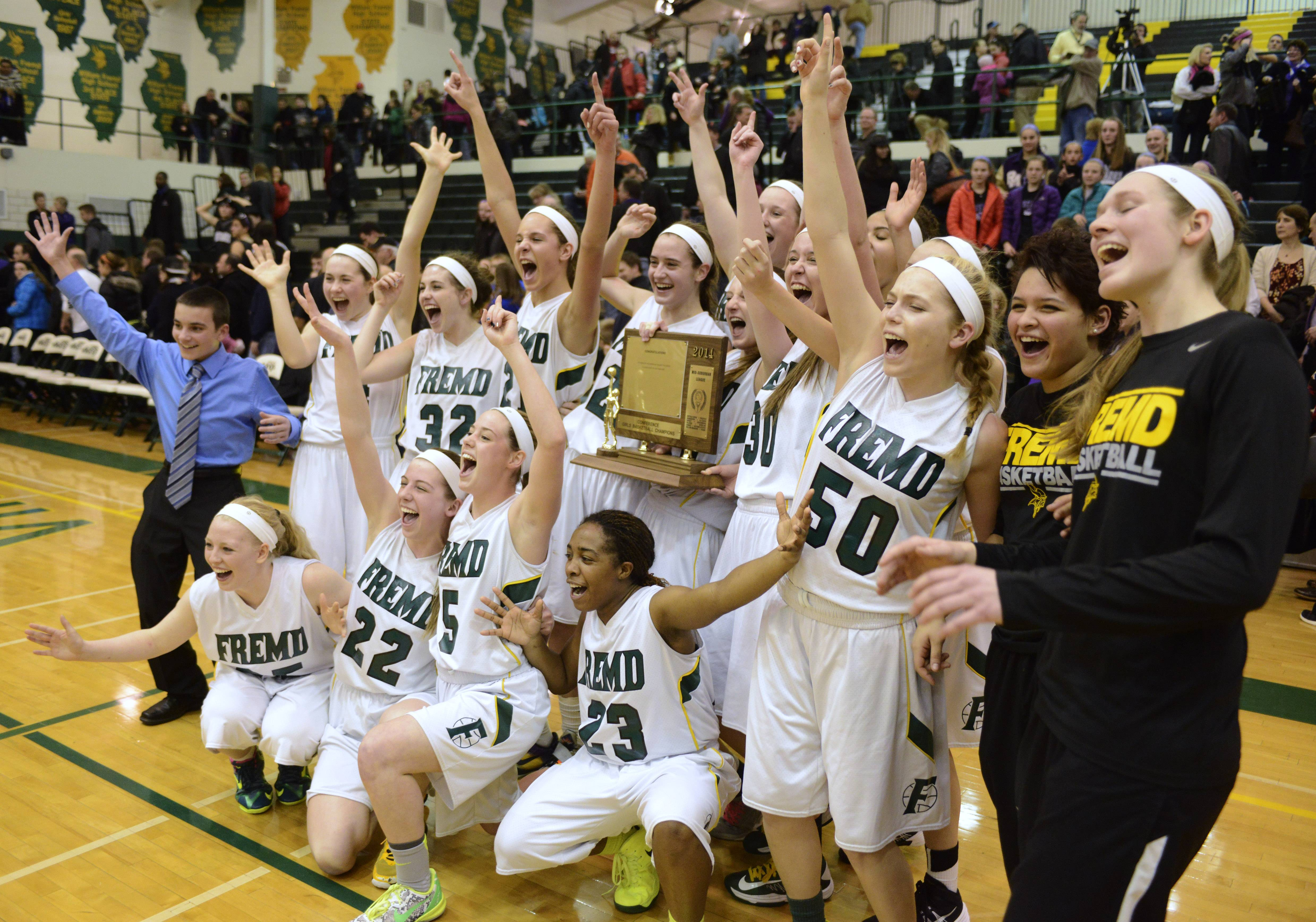 Fremd players celebrate their victory over Rolling Meadows after Wednesday's Mid-Suburban League championship game.