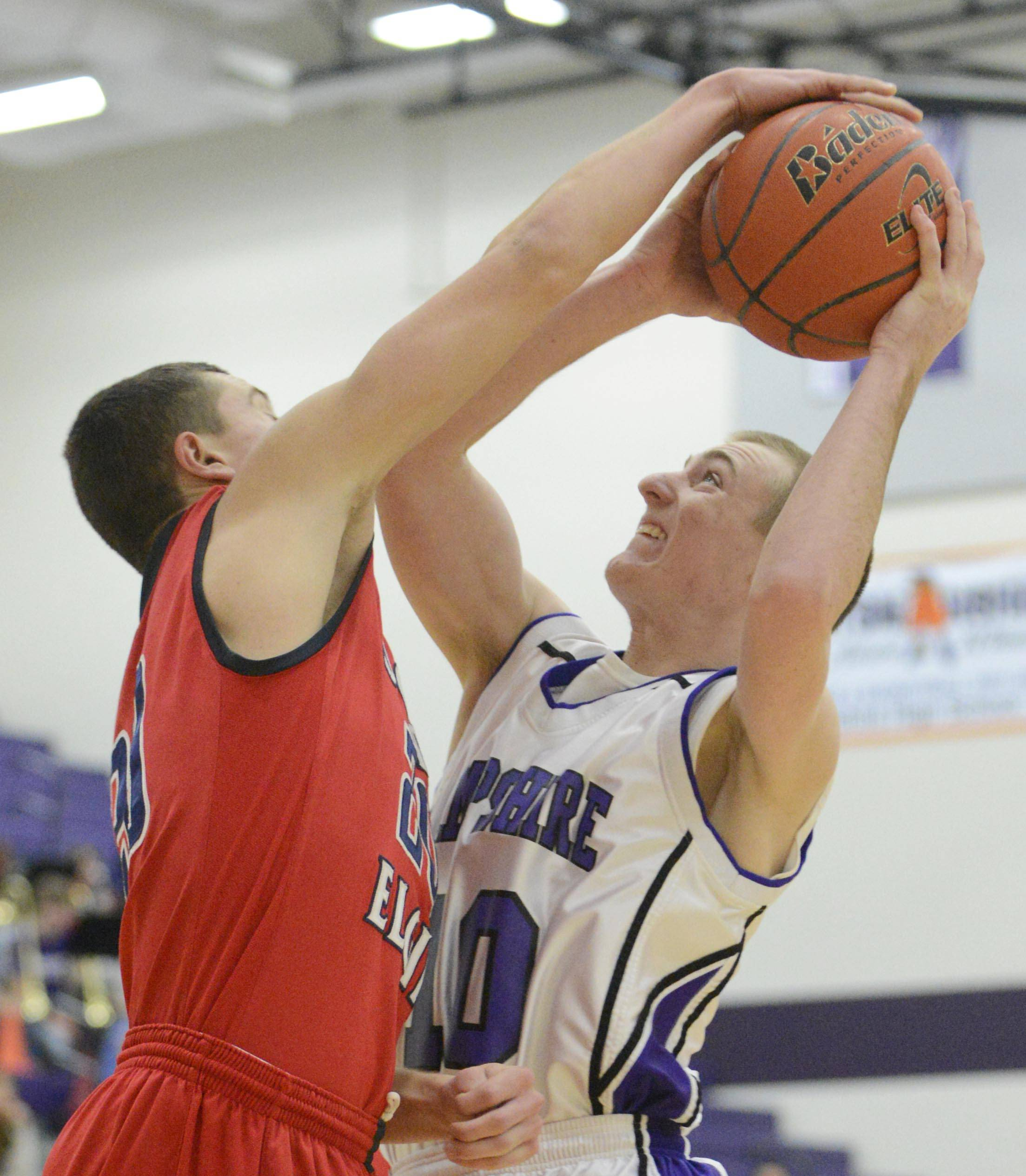 South Elgin's Matt McClure blocks Hampshire's Drew Doran Wednesday in Hampshire.