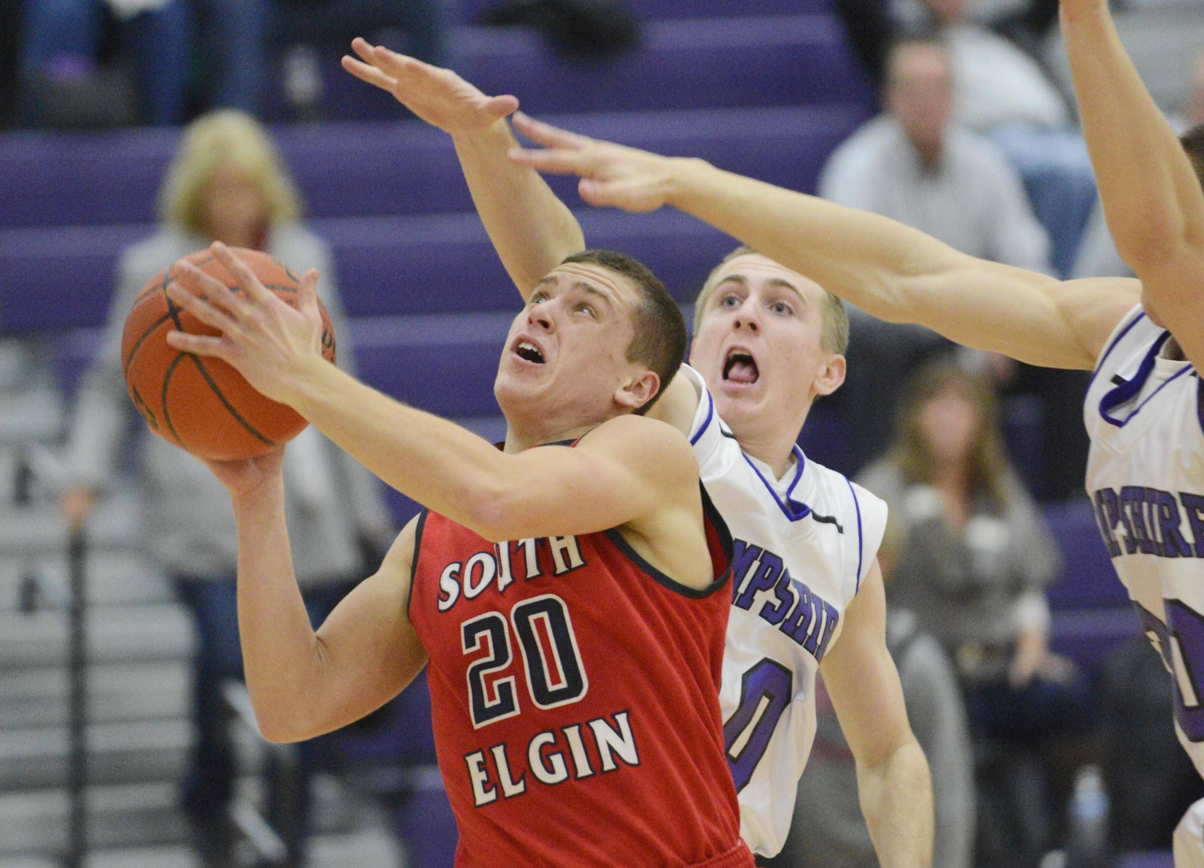 South Elgin's Matt McClure cuts through the defense of Hampshire's Drew Doran and Austin Spaeth Wednesday in Hampshire.