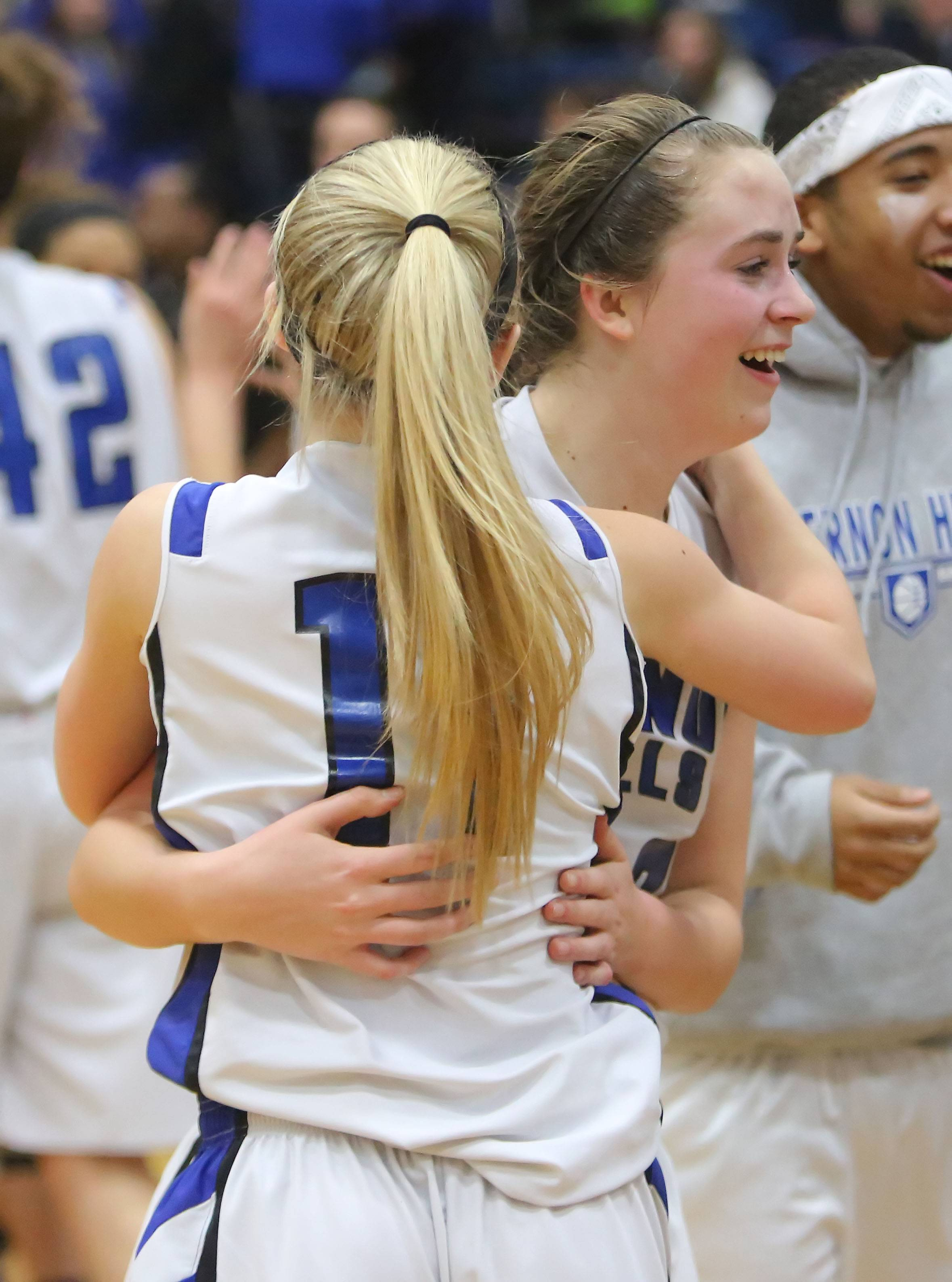 Vernon Hills' Haley Lieberman, left, hugs Monica Bahlmann, who made a 3-pointer near the end of the game to beat Zion-Benton in the North Suburban Conference championship game Wednesday night at Vernon Hills.