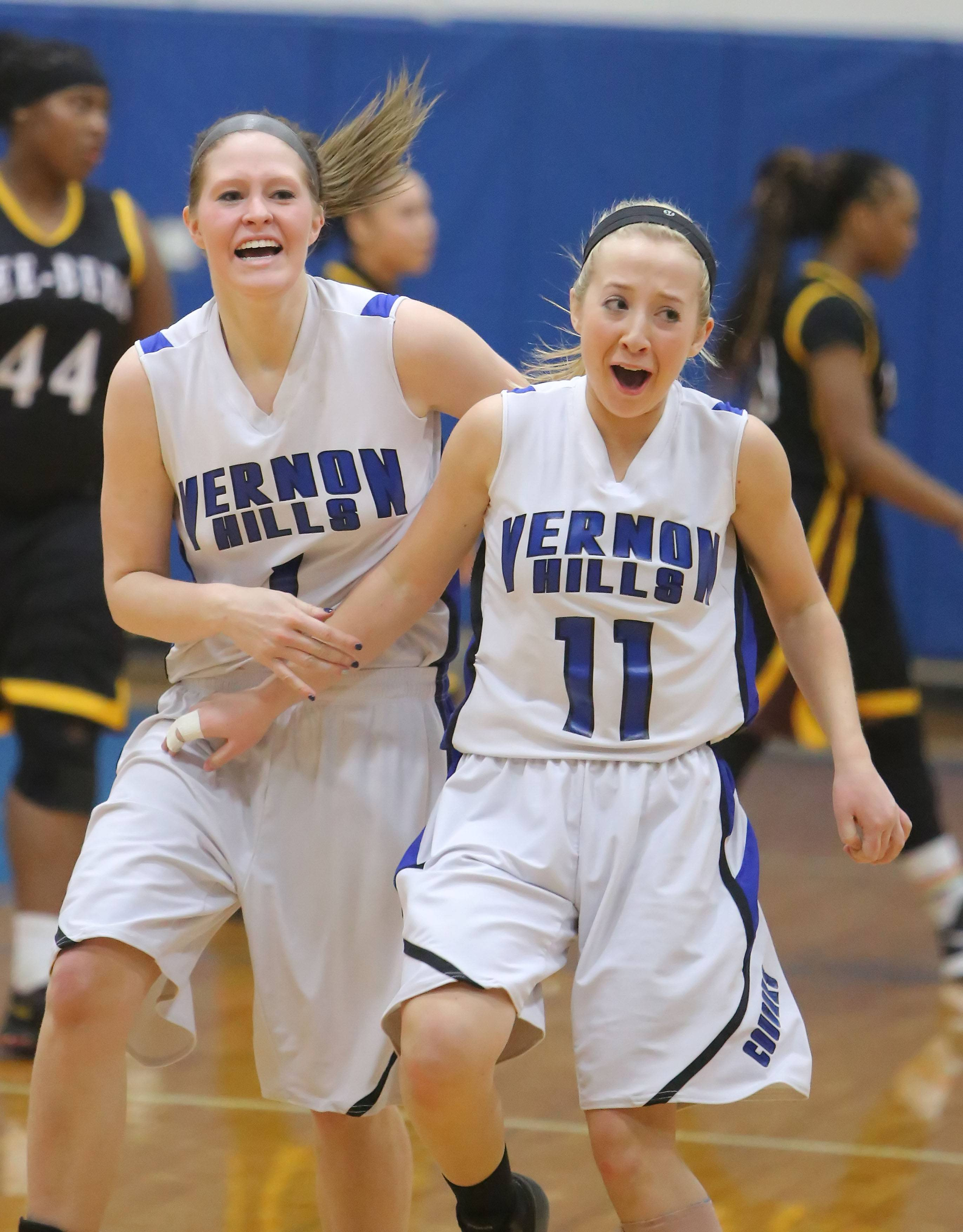 Vernon Hills' Sydney Smith, left, and Haley Lieberman celebrate after beating Zion-Benton in the North Suburban Conference championship game Wednesday night at Vernon Hills.