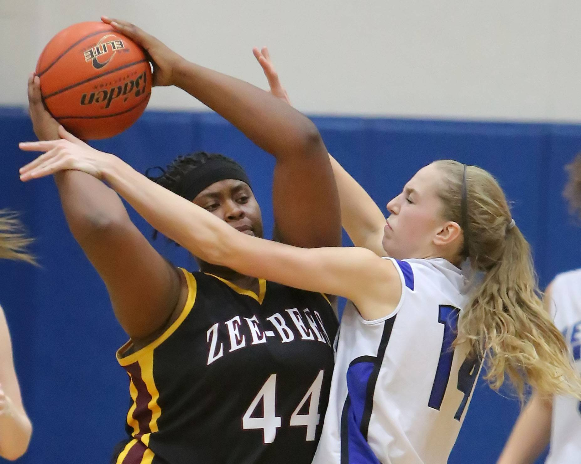 Vernon Hills' Kasey Firnbach, right defends against Zion-Benton's Mia Yarbrough in the North Suburban Conference championship game Wednesday night at Vernon Hills.