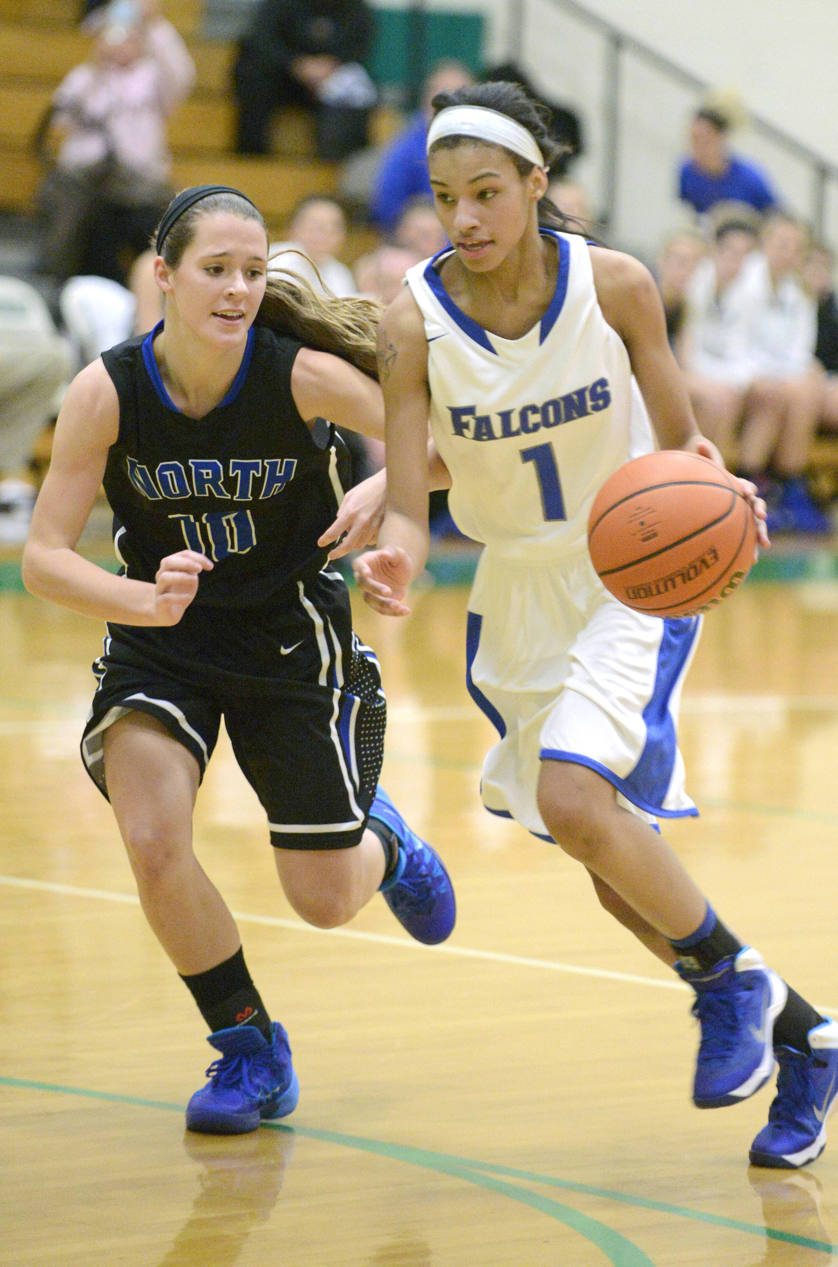 St. Charles North's Ashling Davern, pictured guarding Wheaton North's Emari Jones earlier this season, has received high praise for her defense this year.