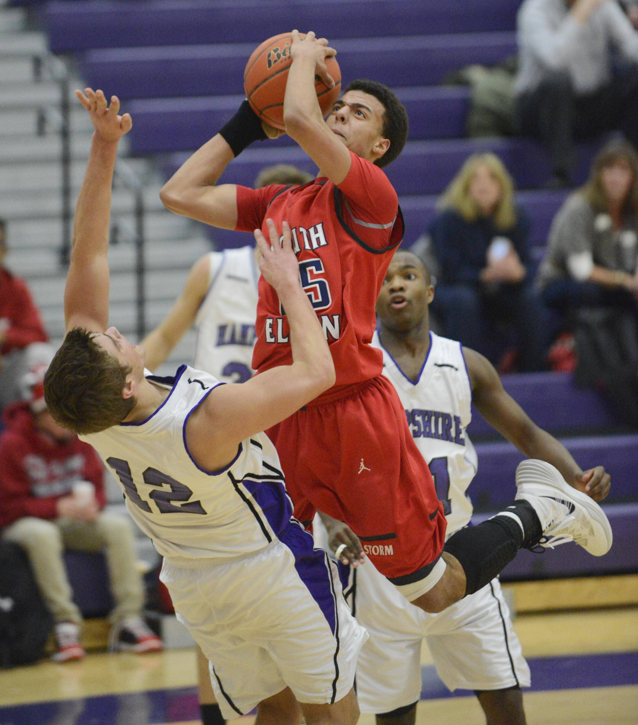 South Elgin's Darius Wells is called for a charge as he runs into Hampshire's Matthew Bridges.