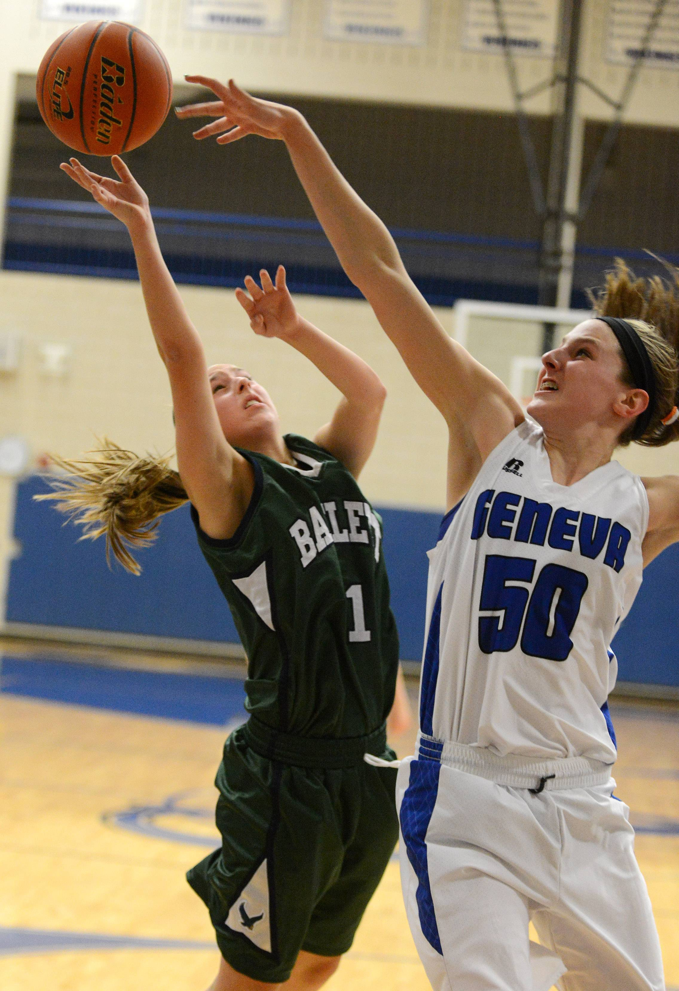 Geneva's Grace Loberg blocks a shot by Bartlett's Shelley Lyjack (11) during Thursday's game in Geneva.