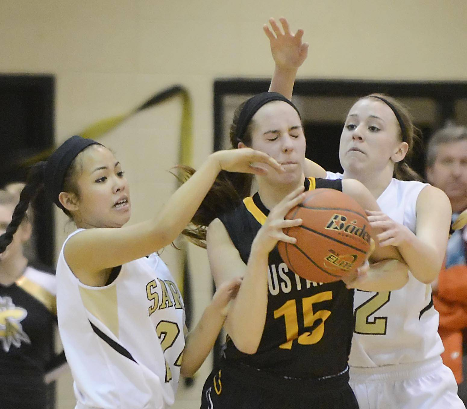 Streamwood's Kiana Jeremiah, left, and Holly Foret double-team Metea Valley's Jenny Voytell Thursday in Streamwood.