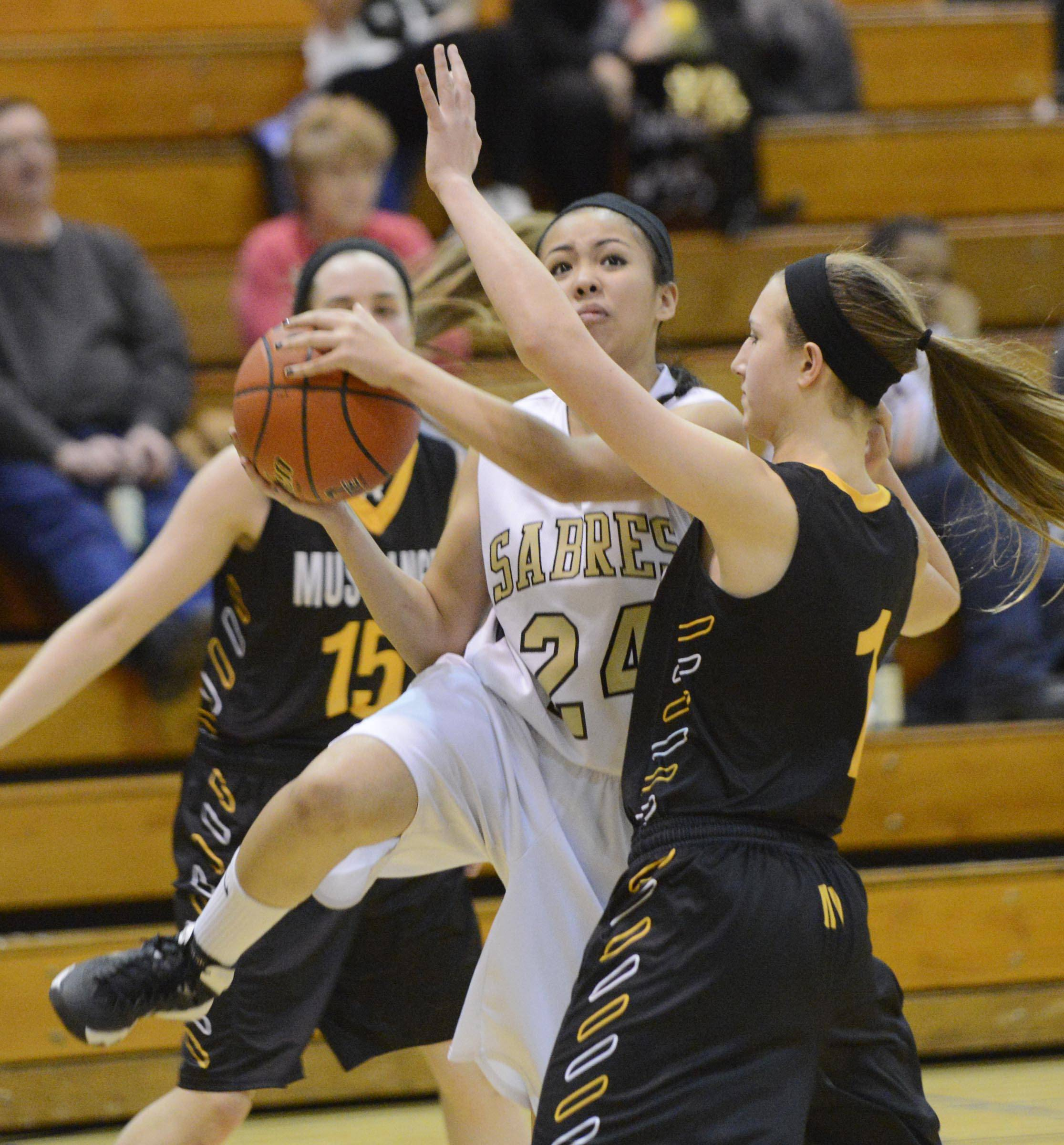 Streamwood's Kiana Jeremiah goes around Metea Valley's Nicki Cast Thursday in Streamwood.