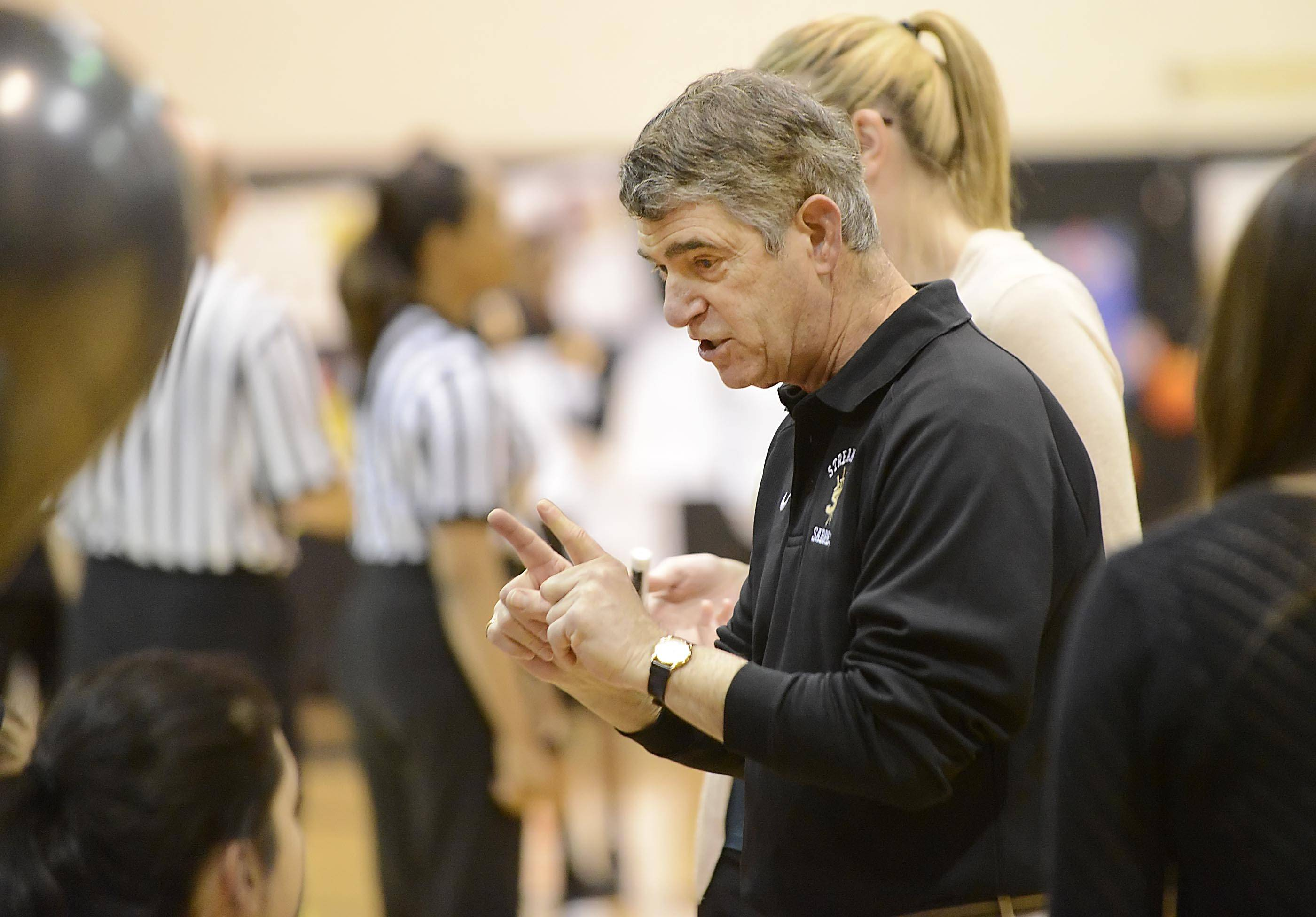 Streamwood head coach George Rosner talks to his team against Metea Valley's Thursday in Streamwood.