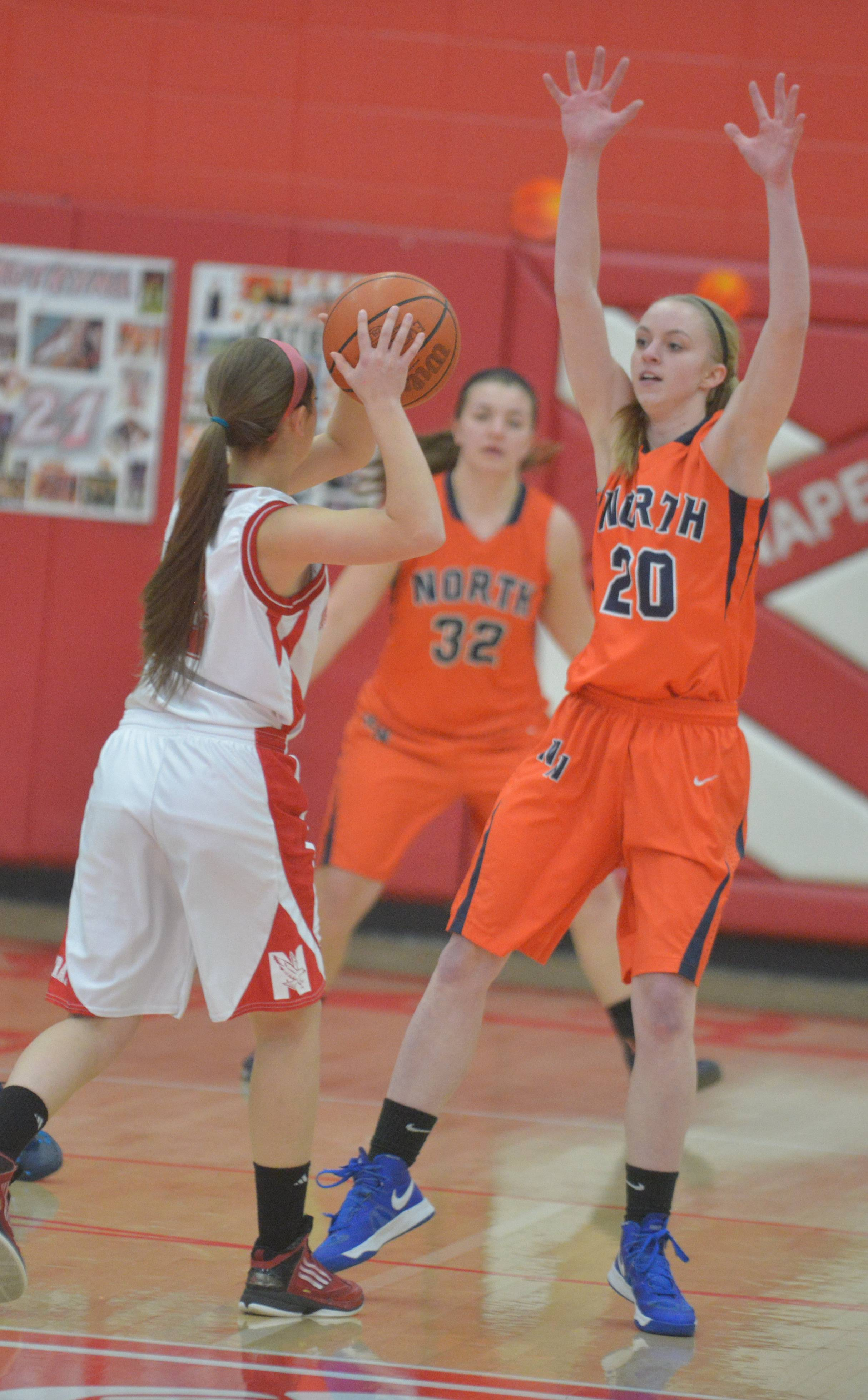 Photos from the Naperville North at Naperville Central girls basketball game Thursday, Feb. 13.