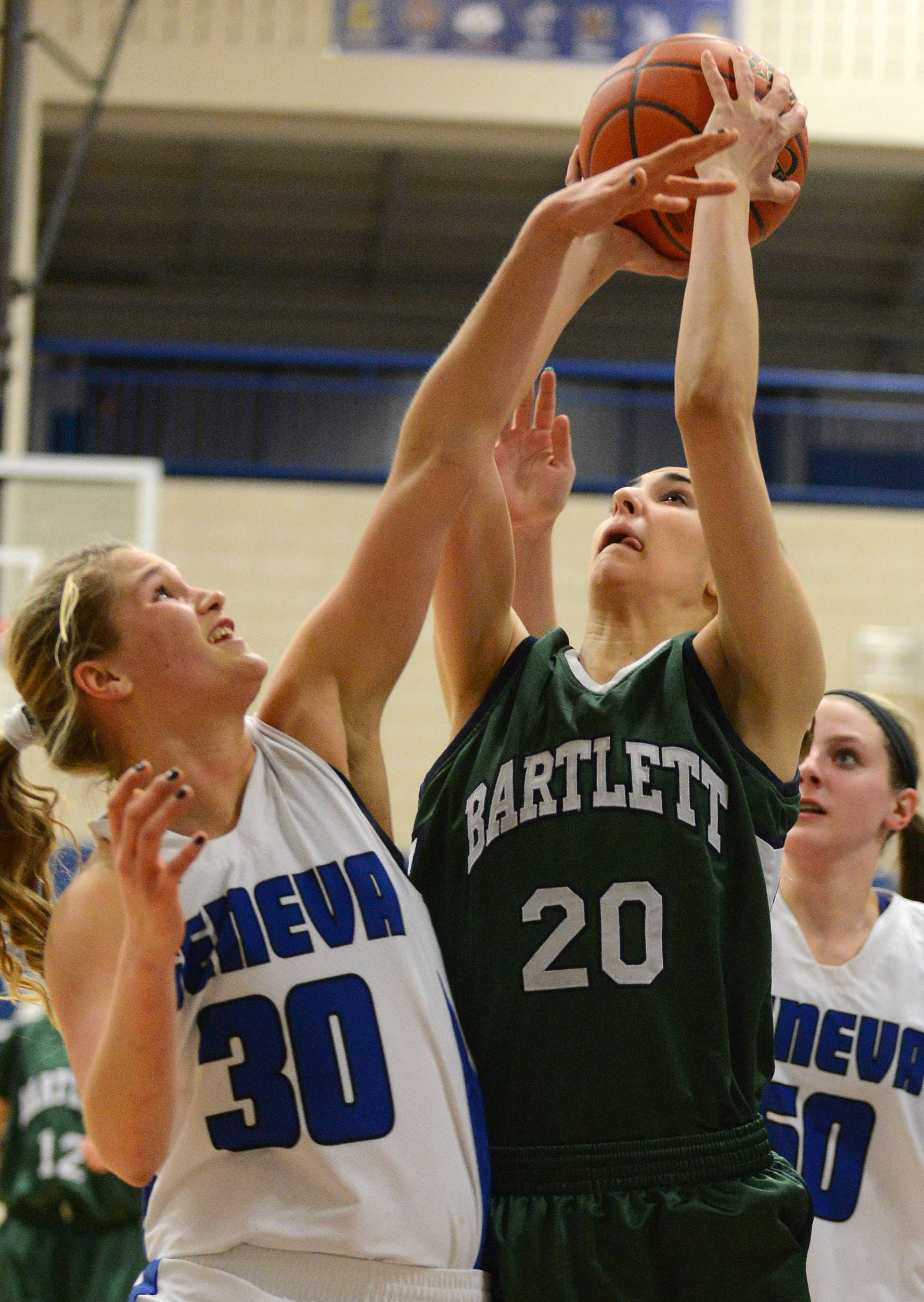 Bartlett's Elizabeth Arco shoots and scores against the defensive effort of Geneva's Janie McCloughan .