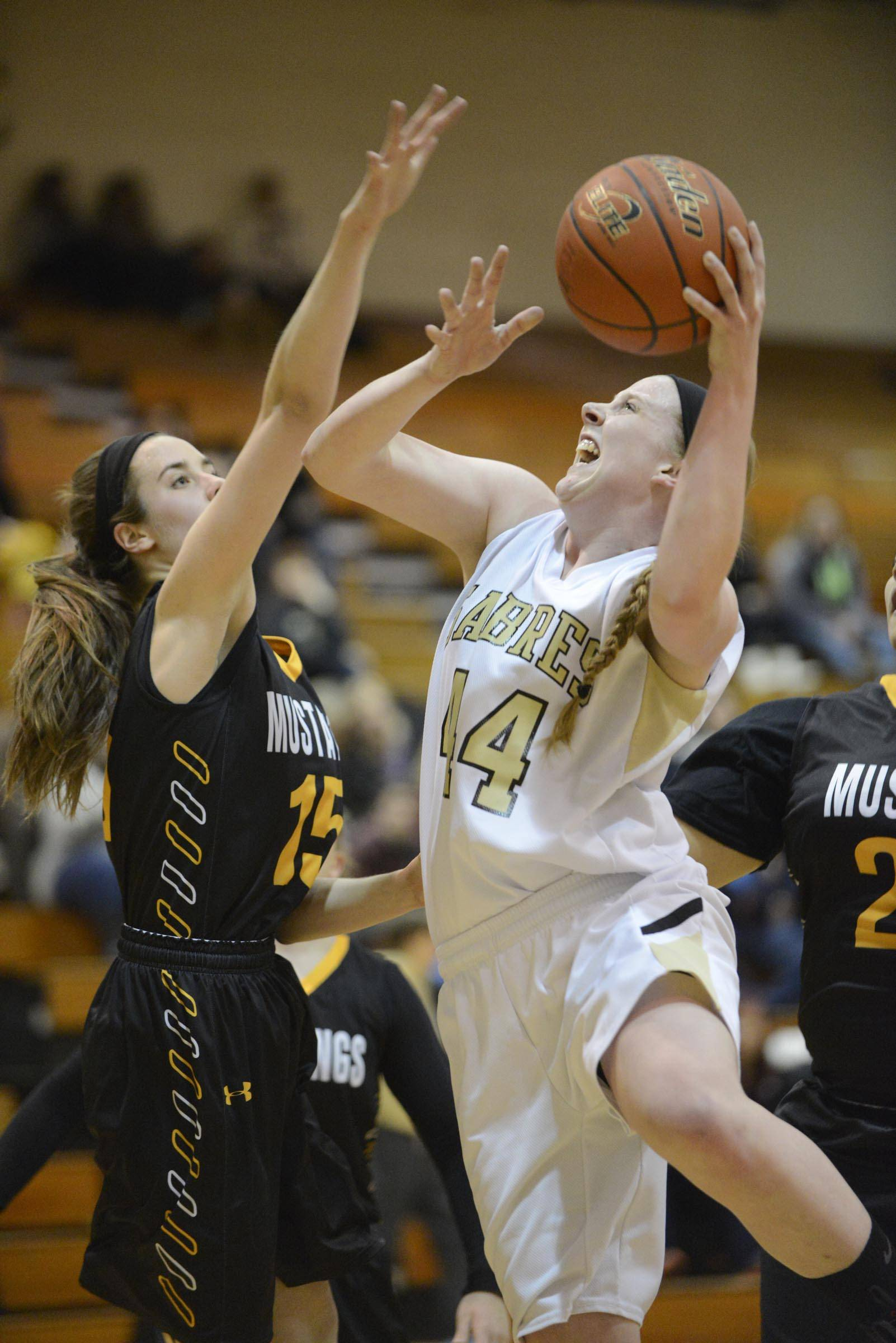 Streamwood's Hannah McGlone shoots around Metea Valley's Jenny Voytell.