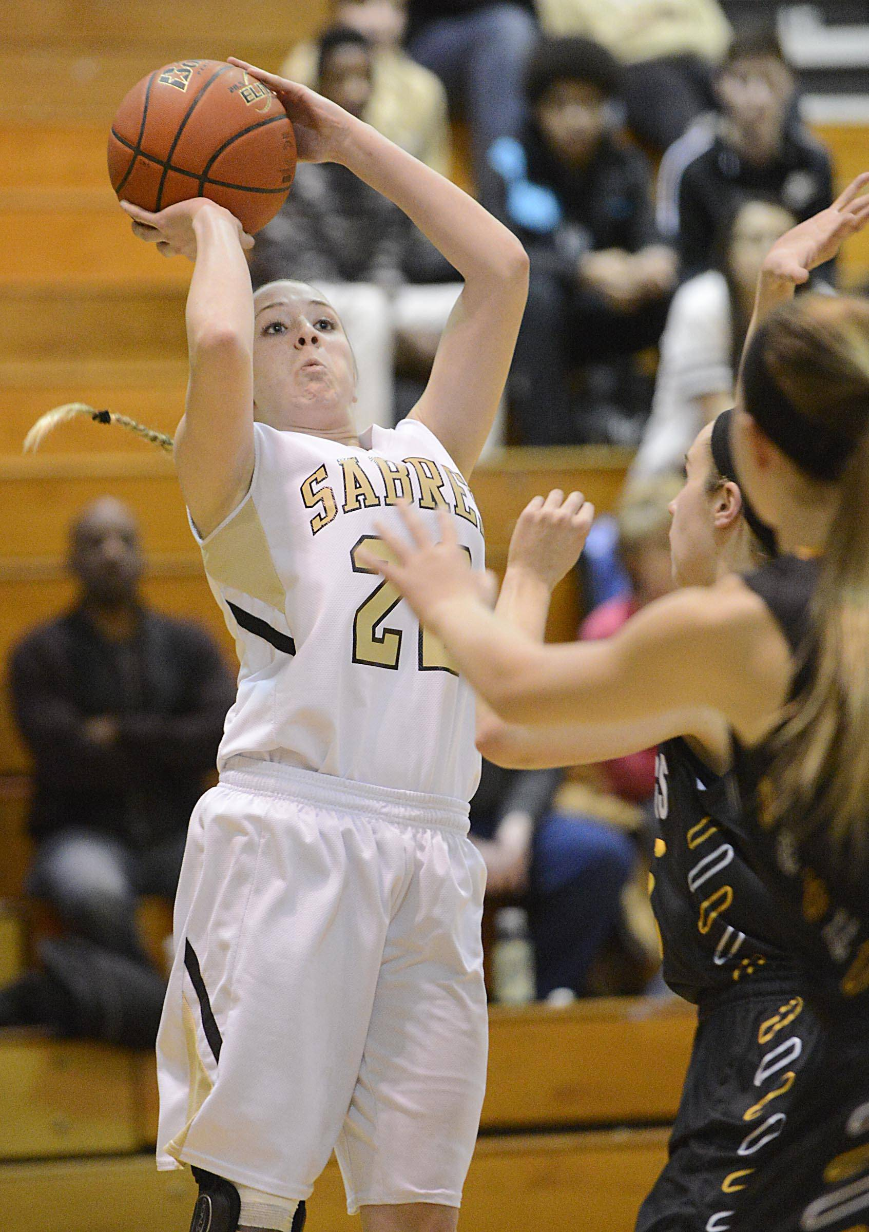 Streamwood's Holly Foret shoots a three-point shot against Metea Valley.