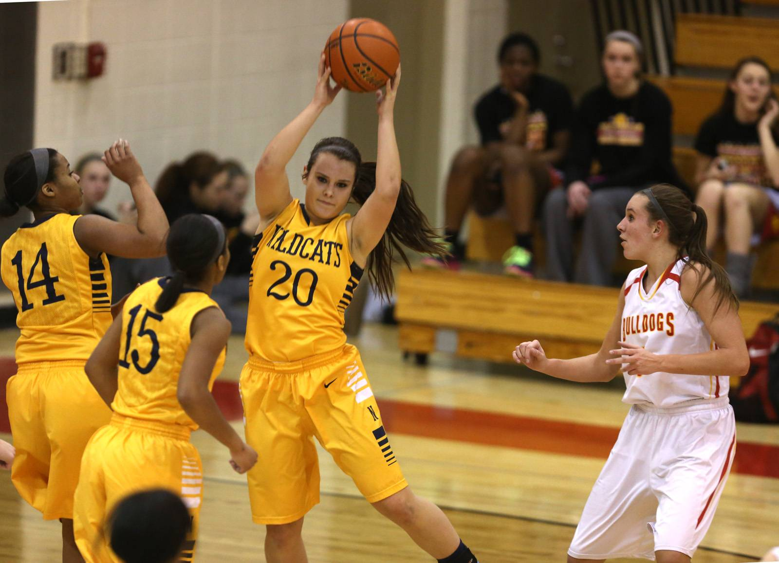 Neuqua Valley's Niki Lazar (20) grabs a rebound against Batavia, during girls basketball action Friday, in Batavia.
