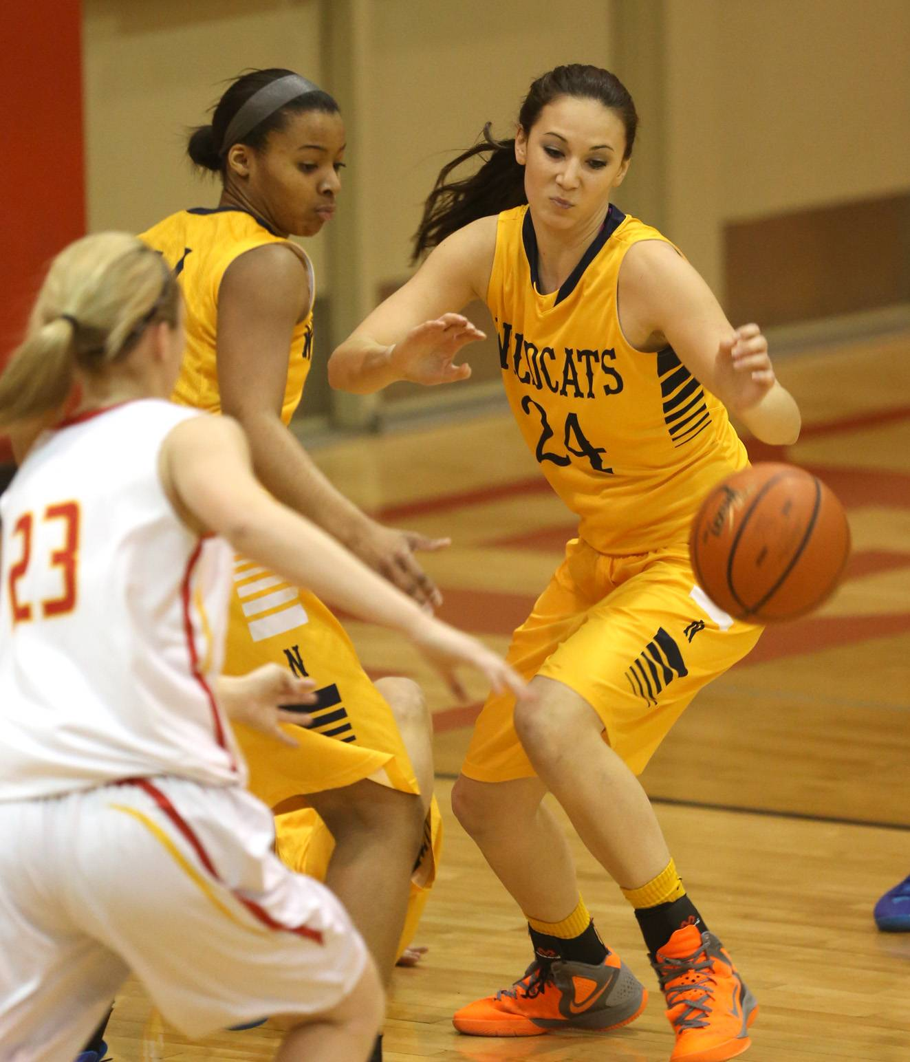 Neuqua Valley's Bryce Menendez (24) eyes the ball against Batavia during girls basketball action Friday, in Batavia.