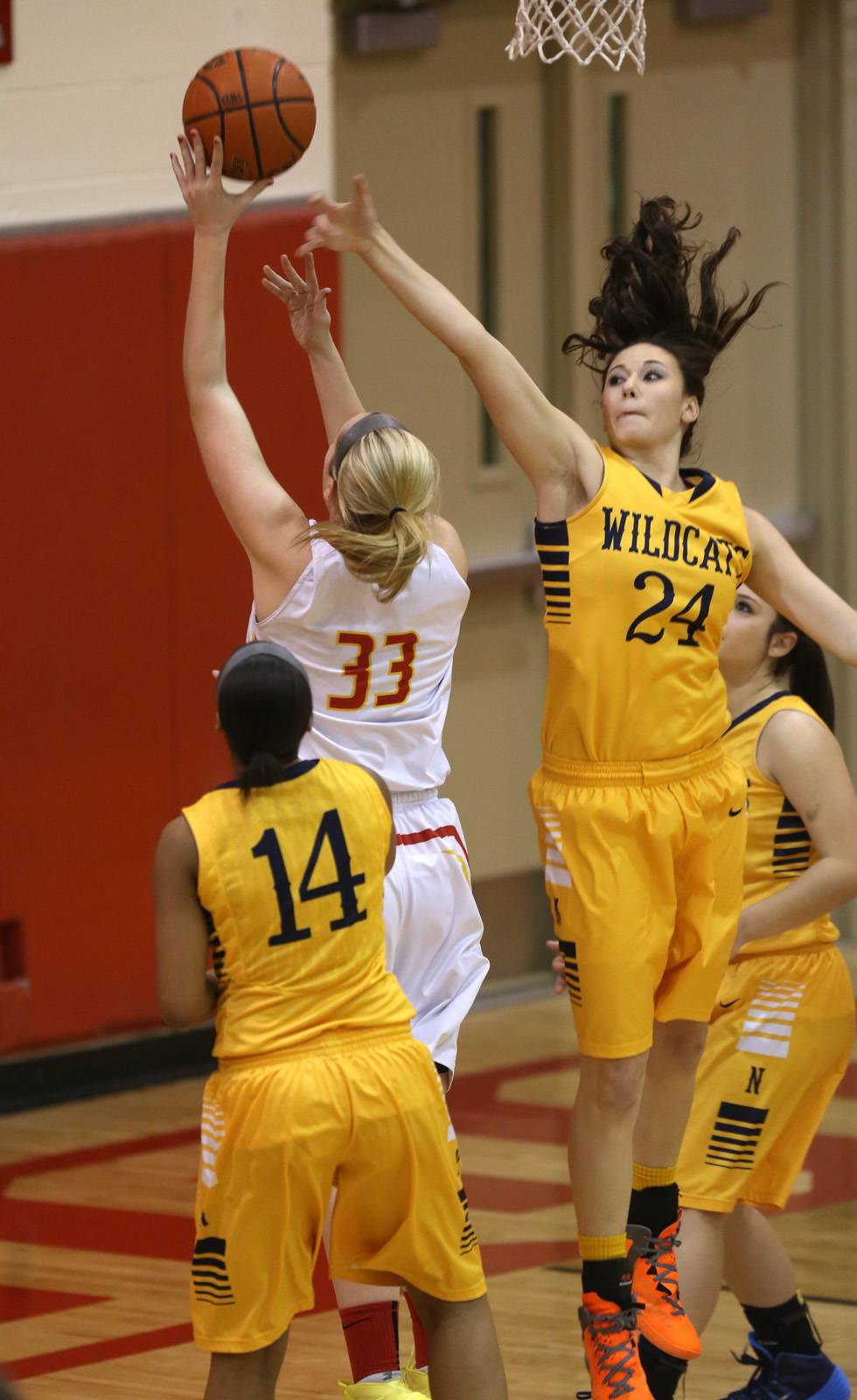 Erin Bayram goes up for 2 of her 16 points against Neuqua Valley's Bryce Menendez Friday in Batavia.