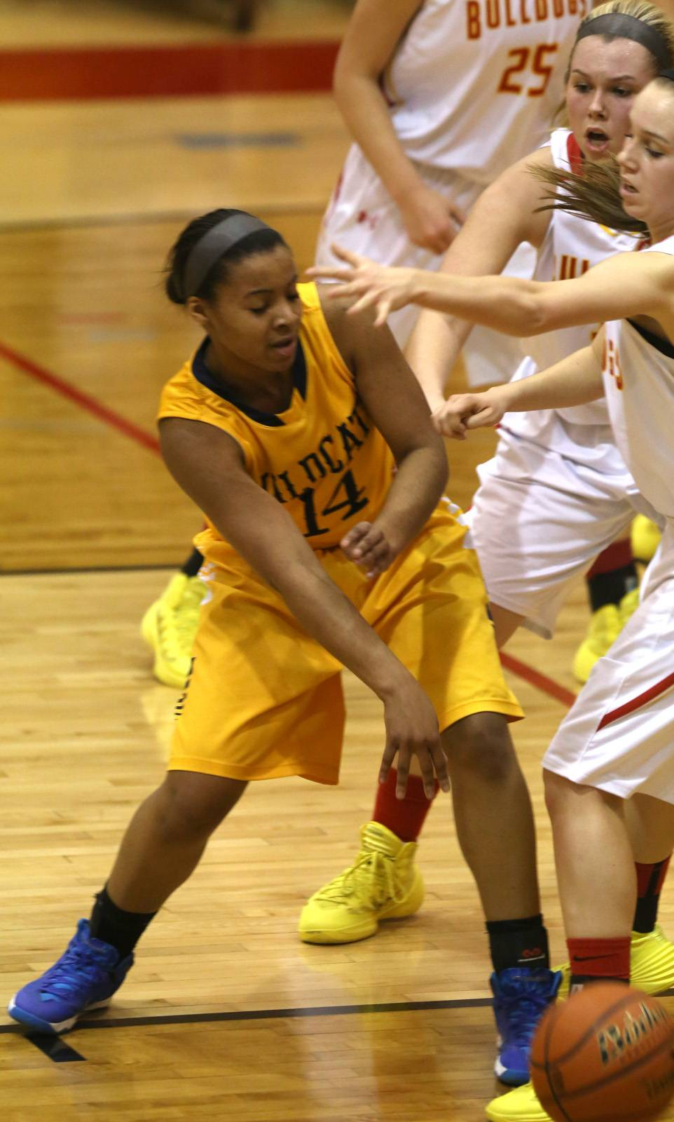 Neuqua Valley's Najee Smith (14) looks to pass inside against battles Batavia during girls basketball action.