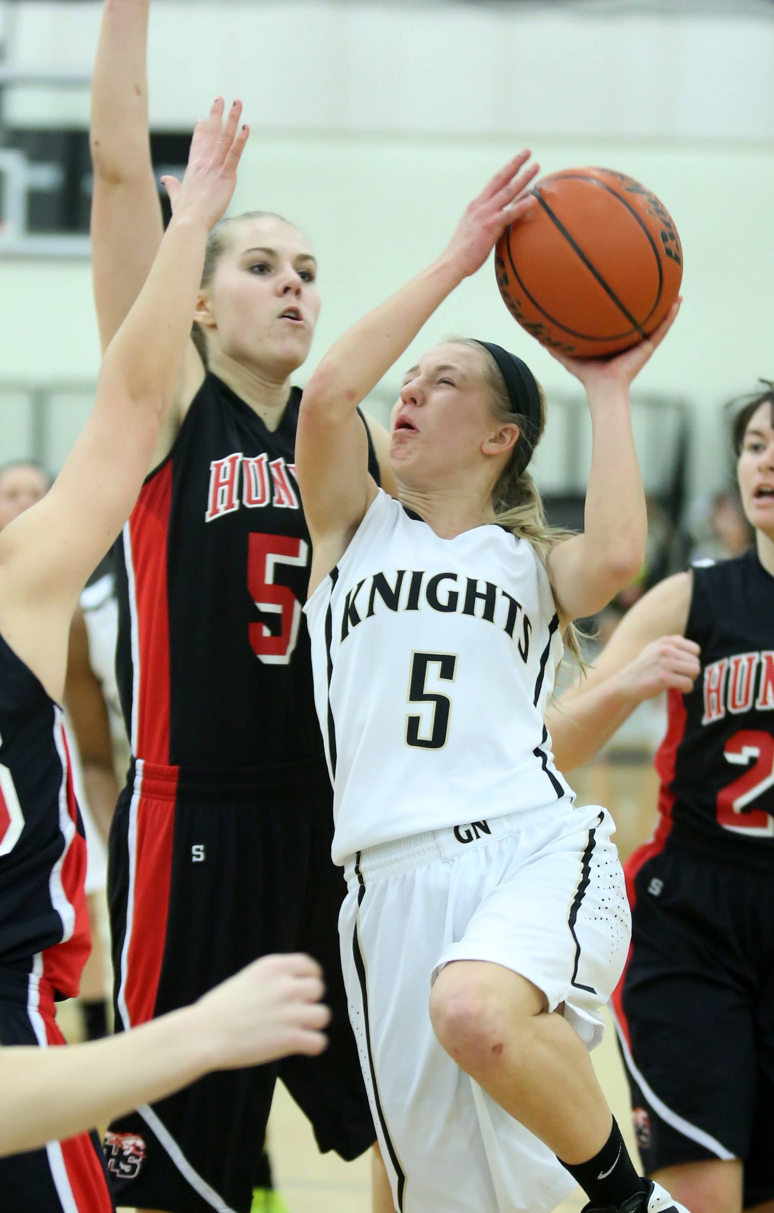 Grayslake North guard Kendall Detweiler shoots against Huntley defender Ali Andrews at Grayslake North on Friday.