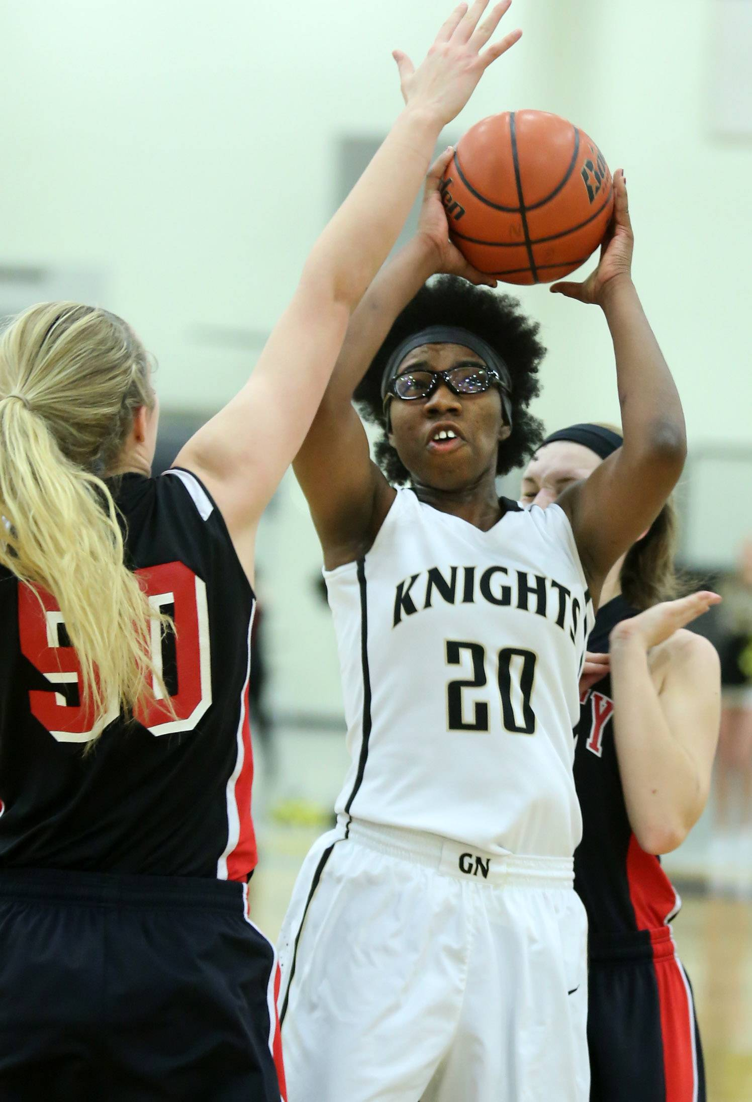 Grayslake North forward Brittany Thiebeaux shoots against Huntley defender Ali Andrews at Grayslake North on Friday.