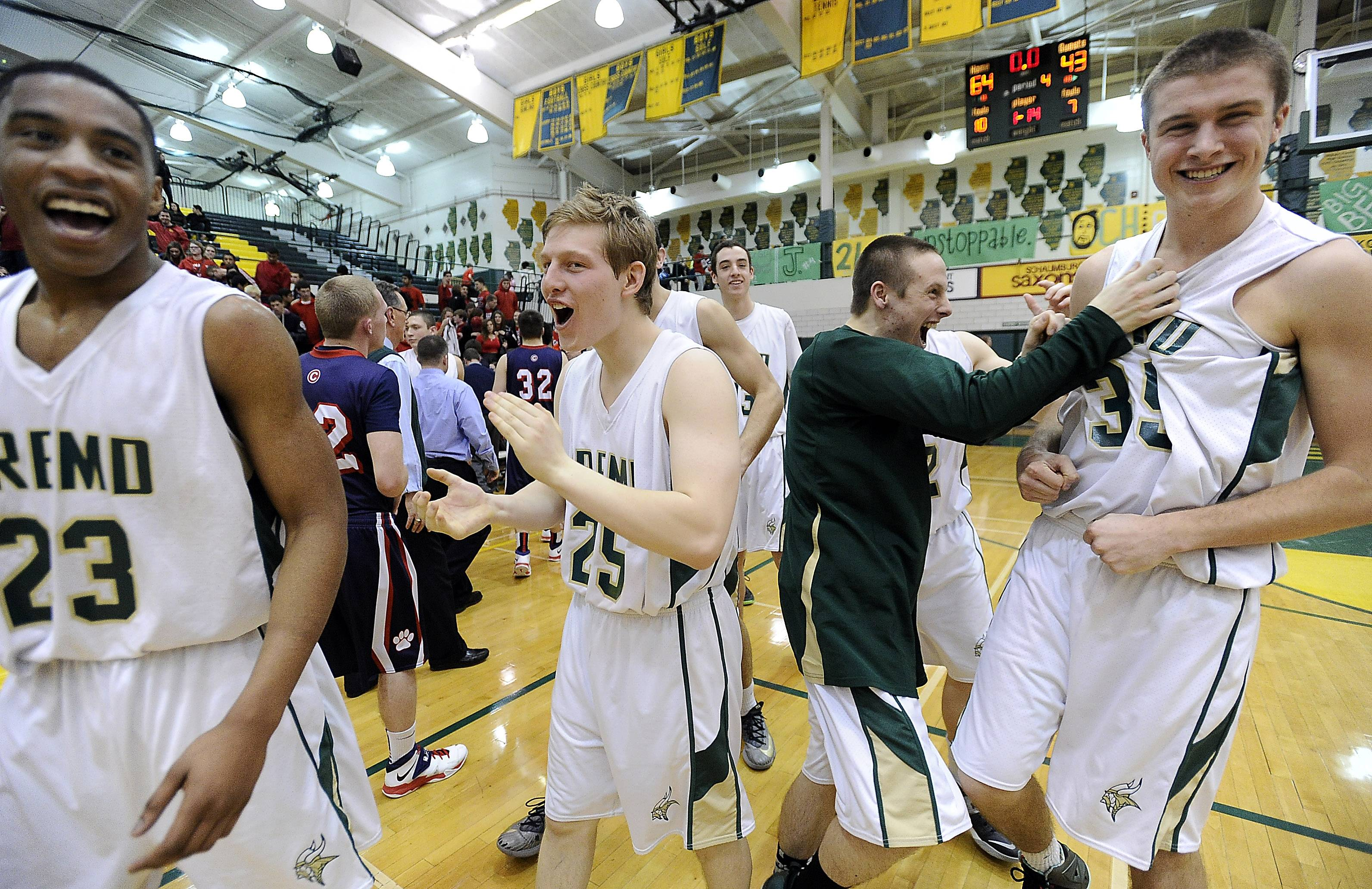 Fremd players celebrate after beating Conant to wrap up the MSL West title at Fremd on Friday.