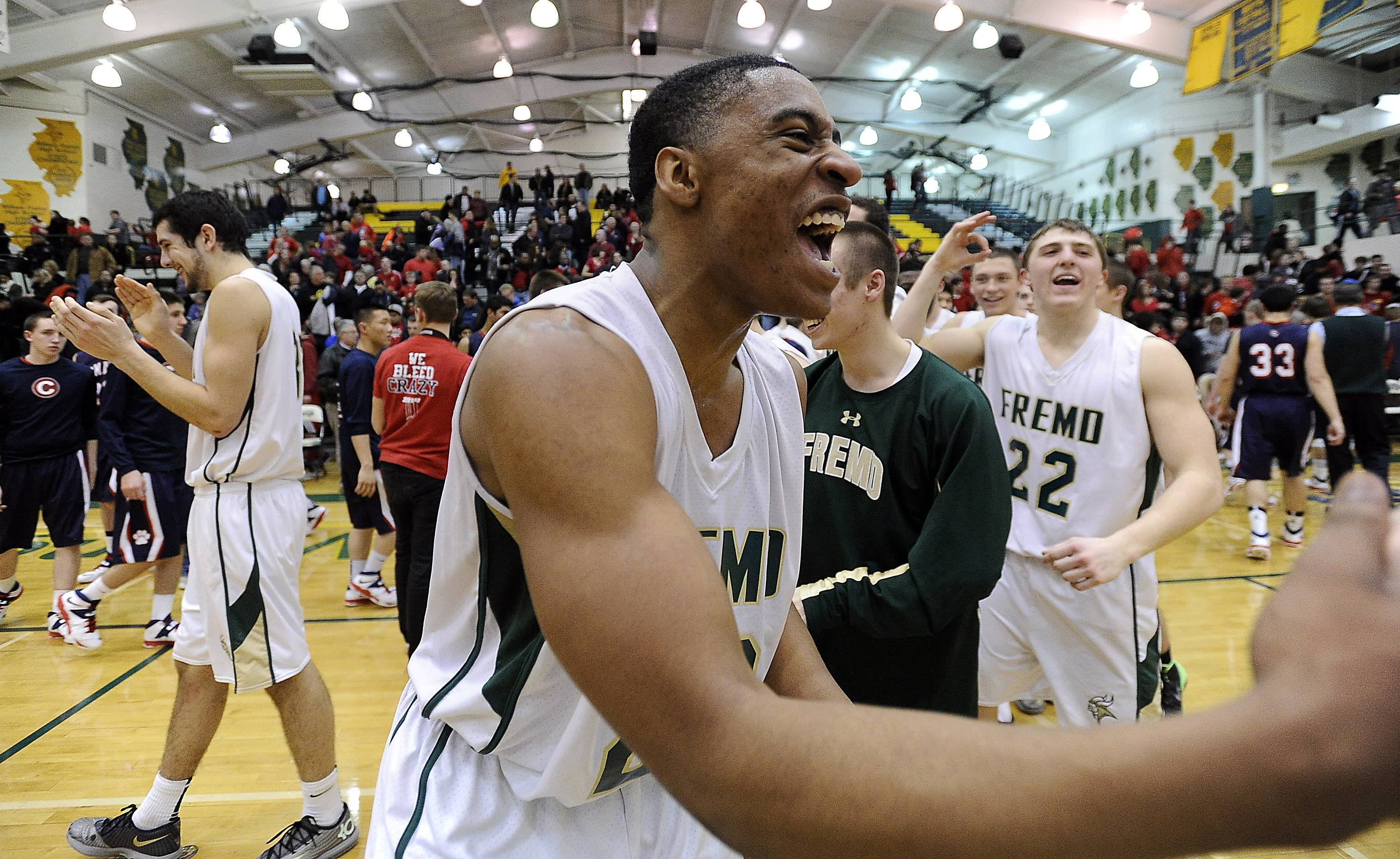 Fremd's Xavier Williams celebrates with his teammates after beating Conant for a share of the MSL West title .