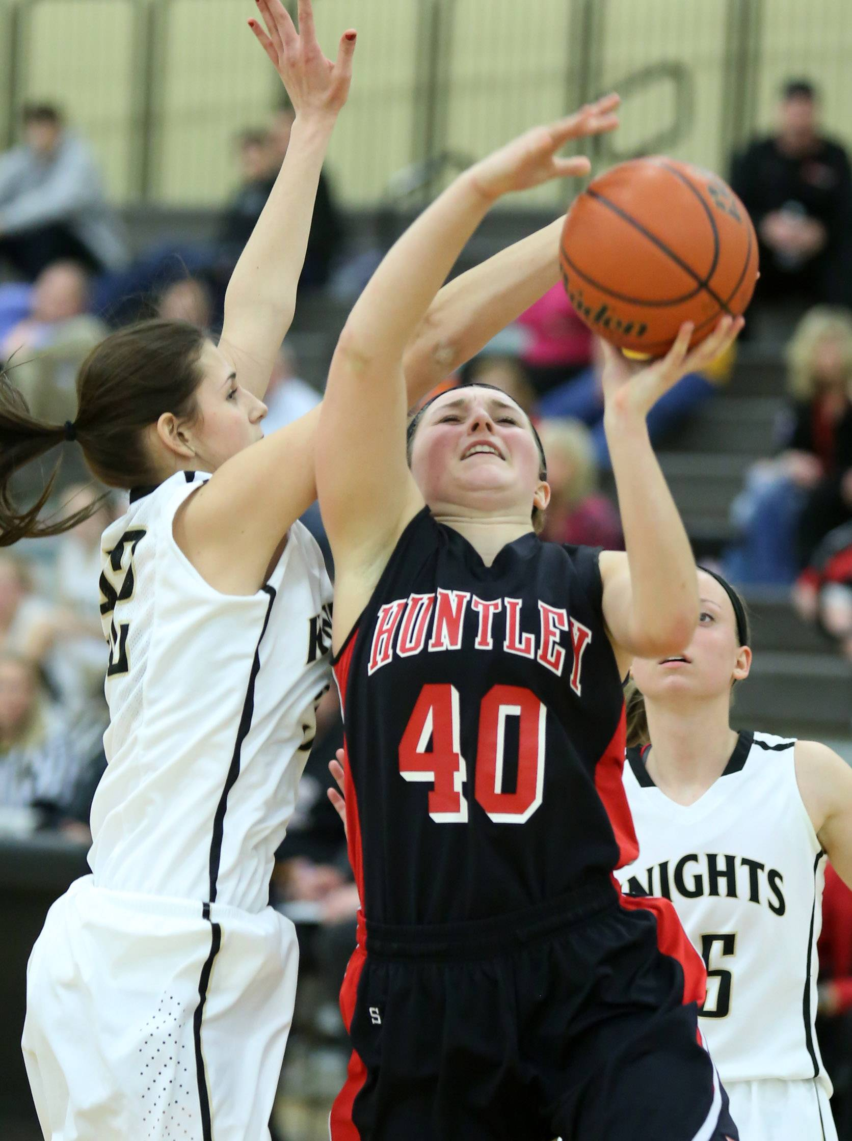 Huntley forward Samantha Andrews shoots over Grayslake North defender Abbey Stinner.